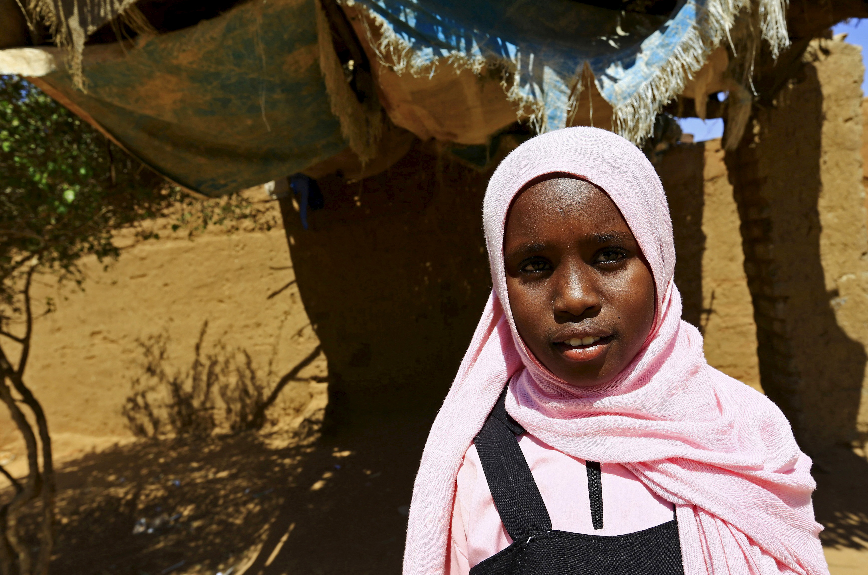 Manasik Yousif Abdo-Rahman, a 4th grader at the Alsalam camps for the internally displaced persons poses for a photograph in El-Fasher in North Darfur, Sudan, Nov.17, 2015.