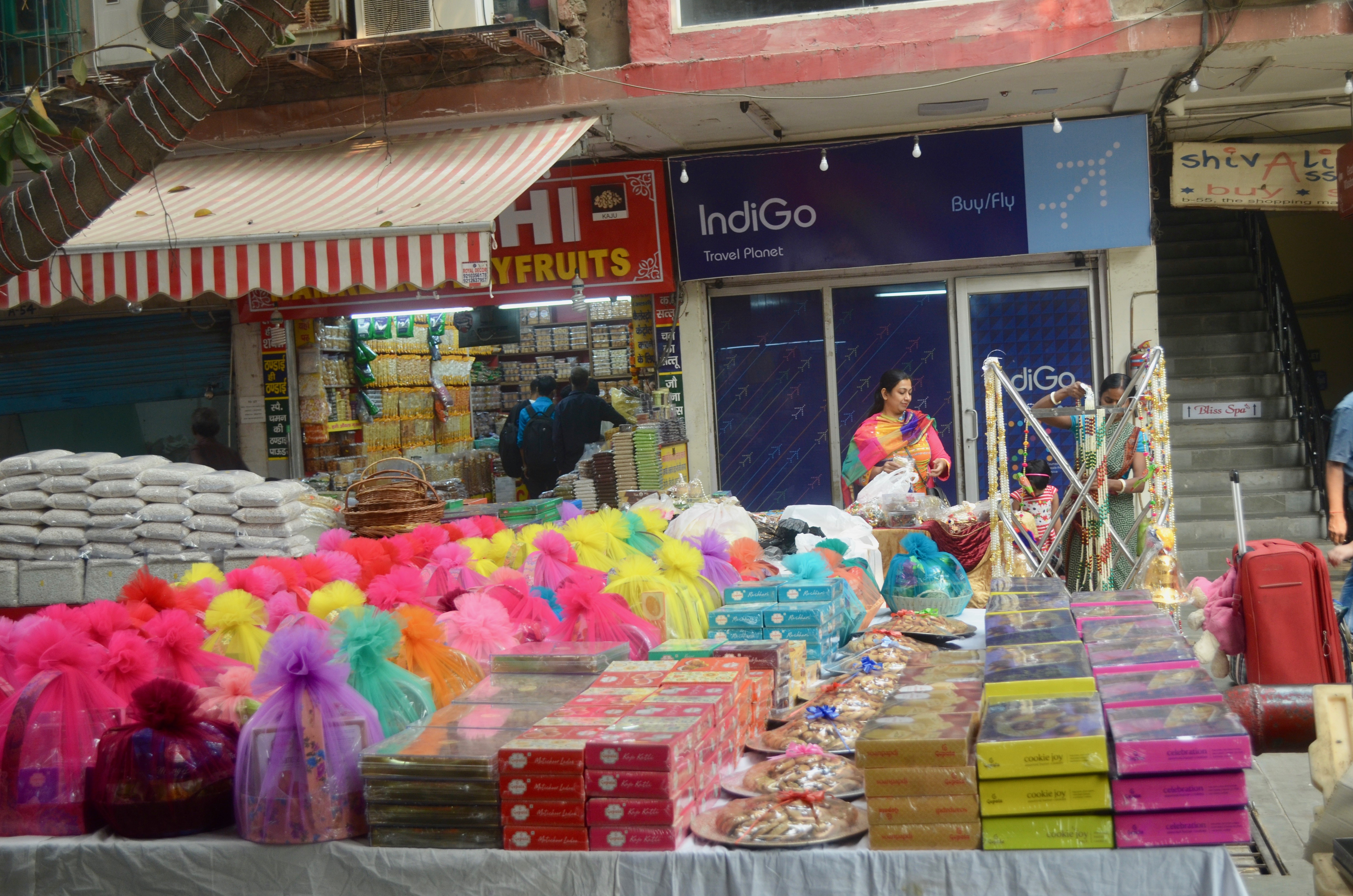 Customers flock to markets selling gifts and sweets for the Hindu festival of Diwali.