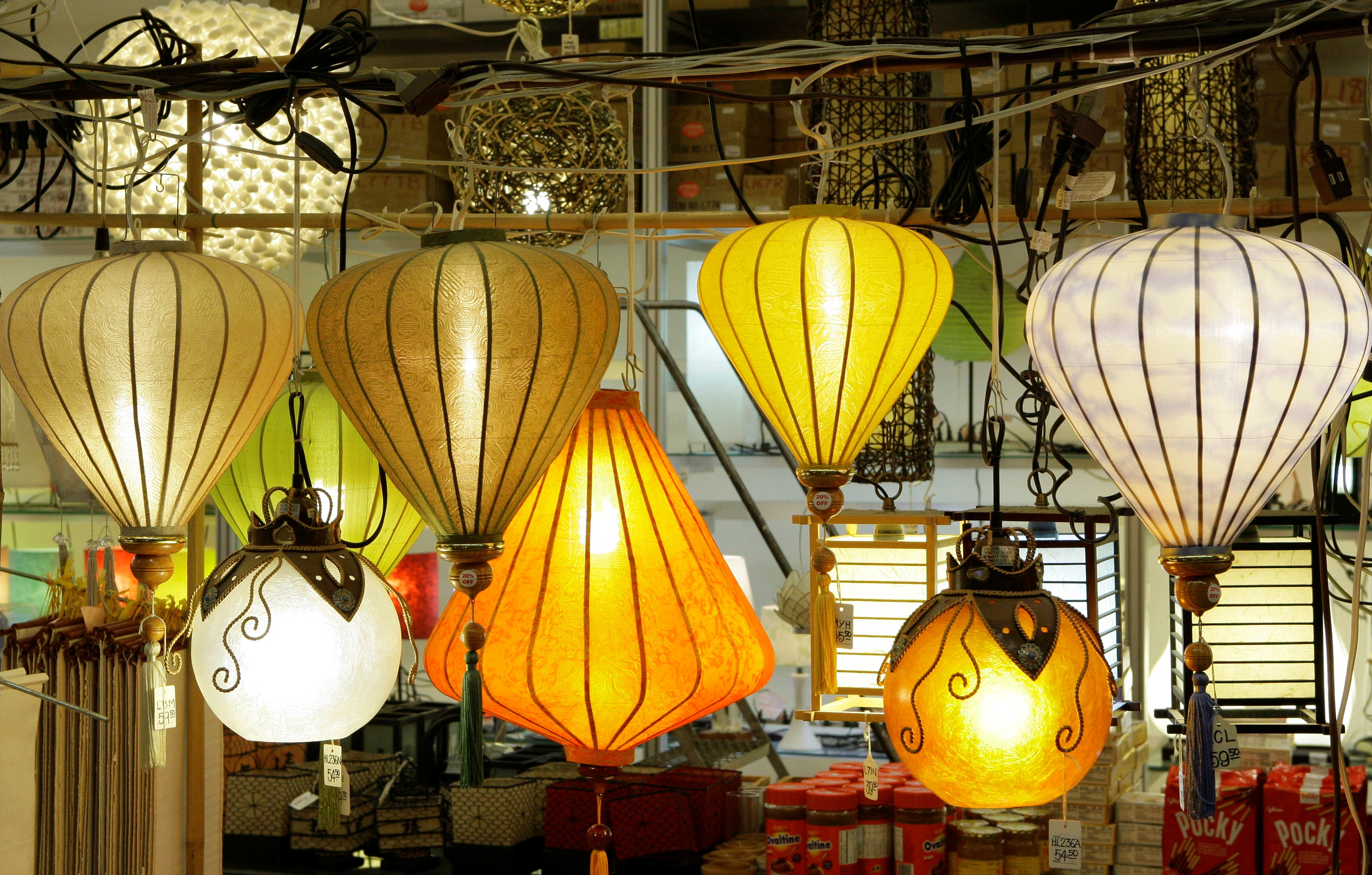 FILE - An array of paper lanterns hang in a display at Pearl River Mart, an emporium for Asian goods in New York. Items at the store range from teapots and ceramic goods to silk purses and Chinese musical instruments.