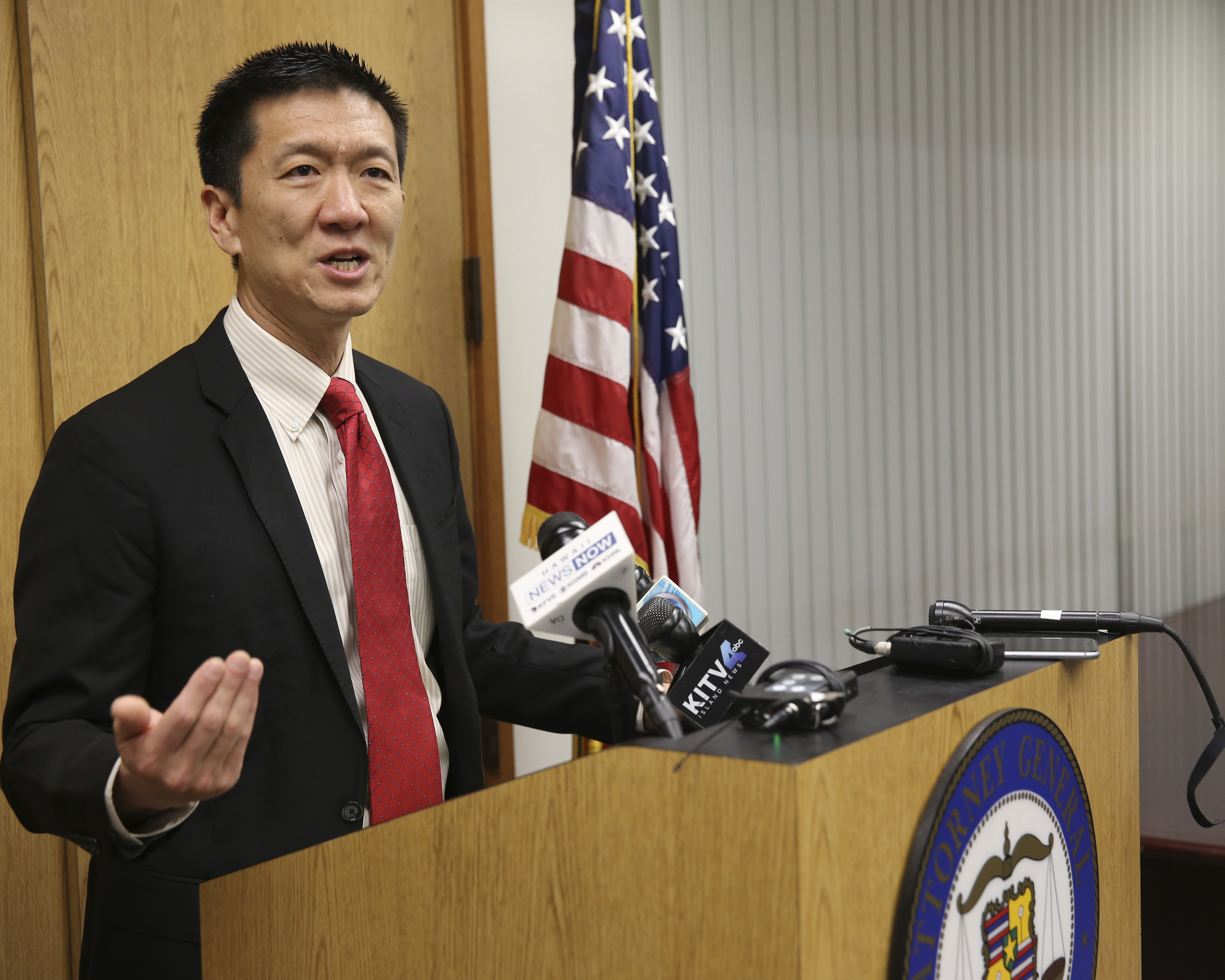 Hawaii Attorney General Douglas Chin speaks at a news conference in Honolulu, March 9, 2017. Chin's office filed an amended lawsuit against President Donald Trump's revised travel ban.