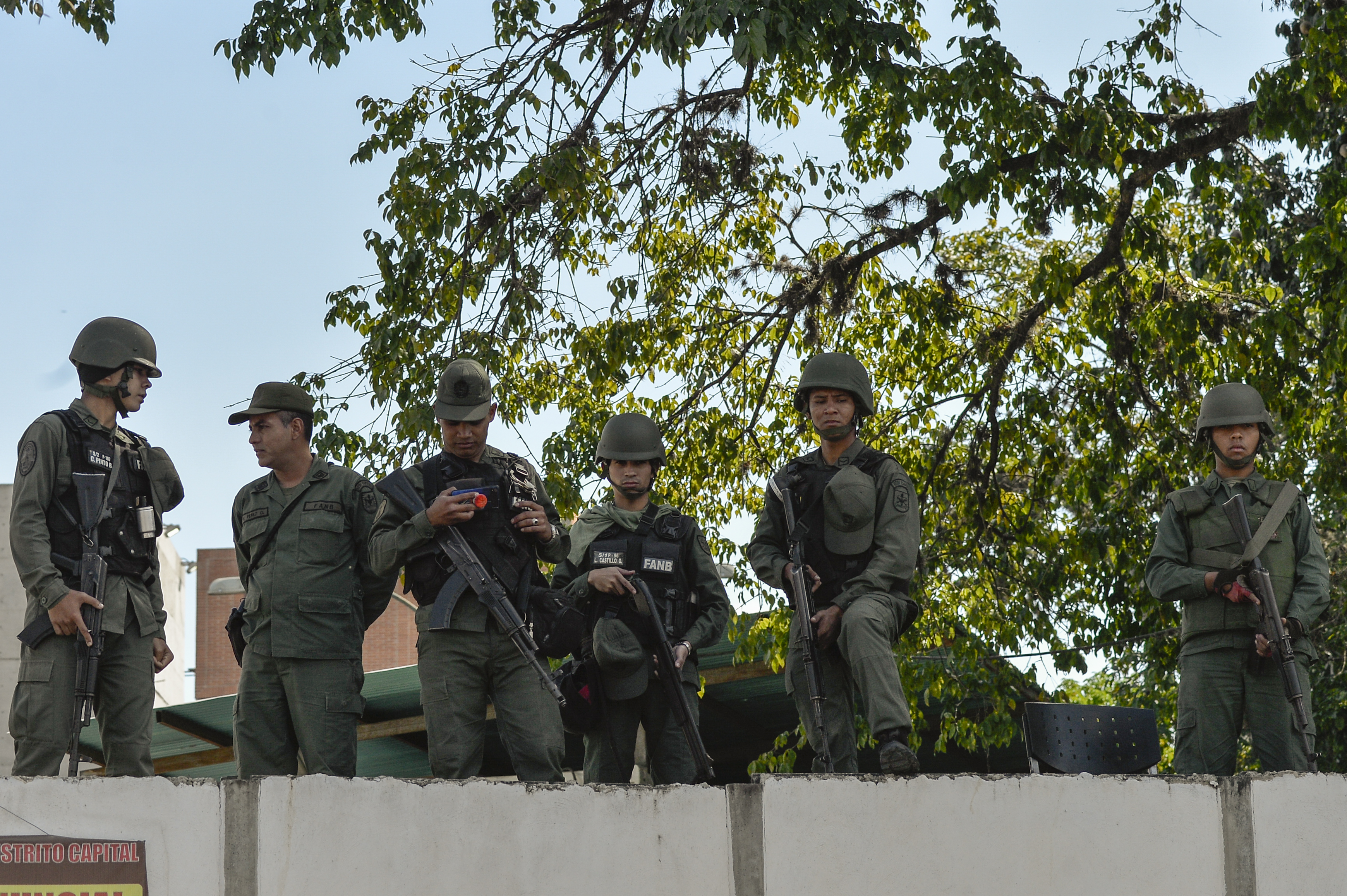 Soldiers are seen at a military headquarter as opposition supporters (not pictured) give out copies of amnesty measures to anyone in the military who disavows President Nicolas Maduro, in Caracas, Venezuela, Jan. 27, 2019.