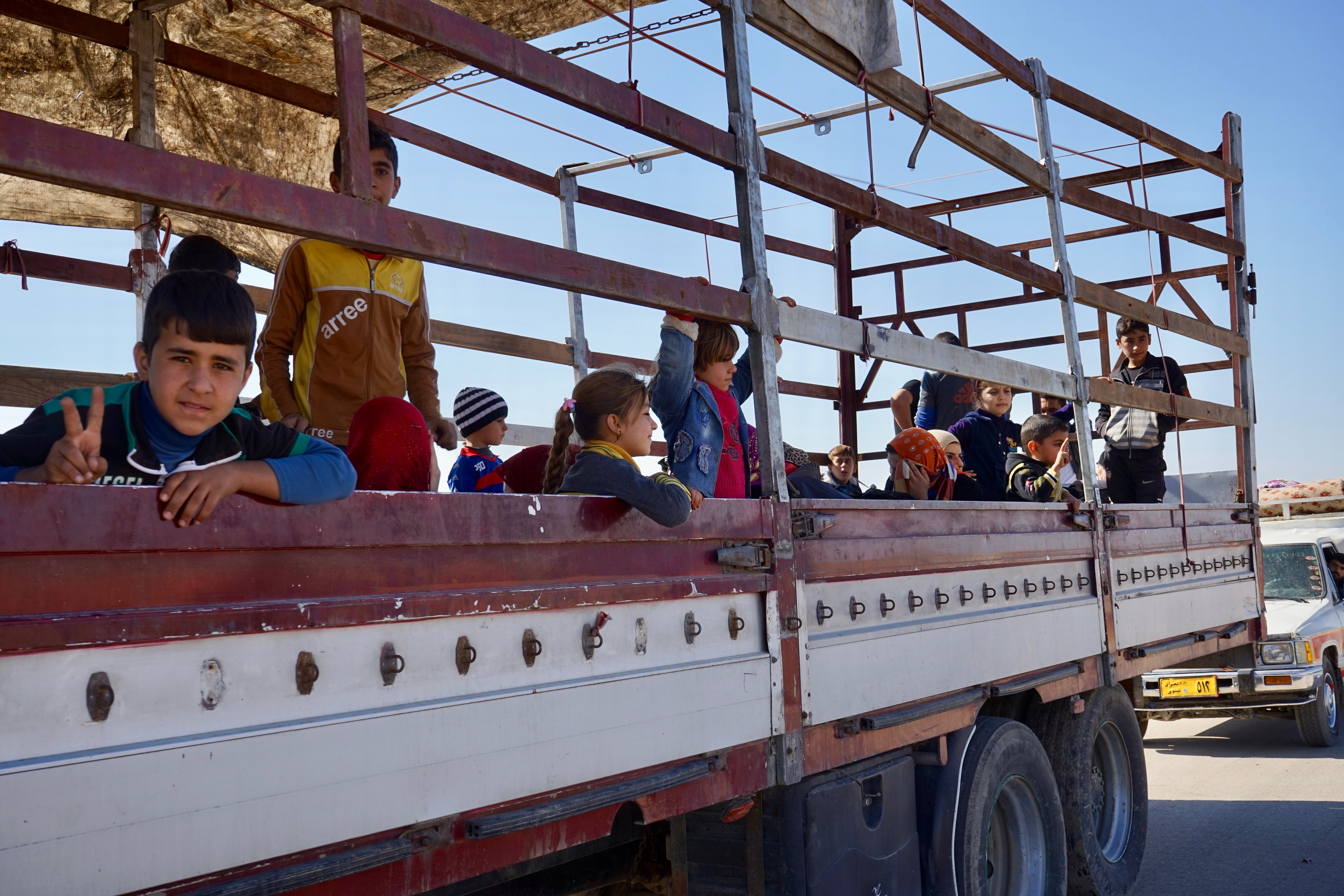 Hundreds of civilians flooded out of eastern Mosul Thursday hitching a ride on any transport they could find, Nov. 3, 2016. (Photo: Jamie Dettmer for VOA)