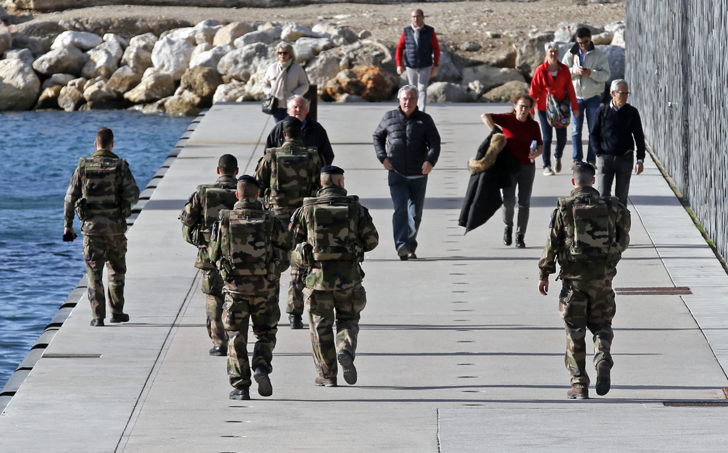 French soldiers patrol near the Museum of Civilizations from Europe and the Mediterranean (MuCEM) in Marseille, France, as security increases after last Friday's deadly attacks in Paris, Nov. 20, 2015.
