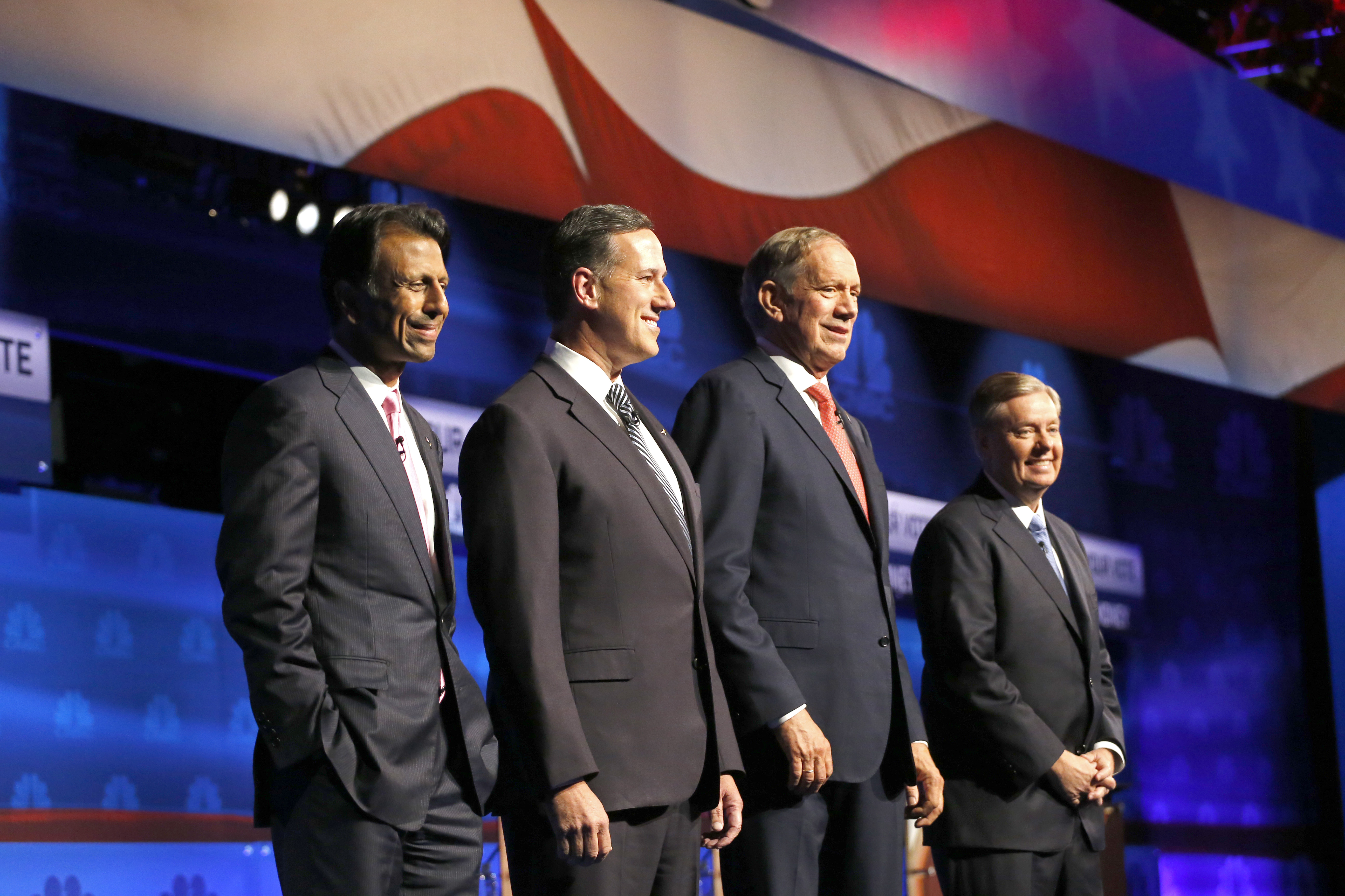 Republican presidential candidates, from left, Bobby Jindal, Rick Santorum, George Pataki, and Lindsey Graham take the stage during the CNBC Republican presidential debate at the University of Colorado, in Boulder, Colo., Oct. 28, 2015.