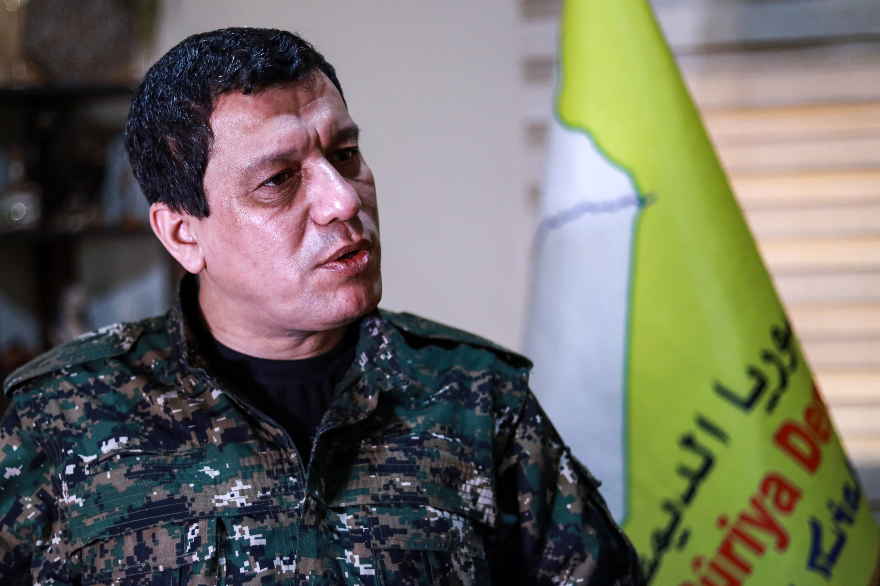 FILE - Mazloum Kobani, commander-in-chief of the Syrian Democratic Forces (SDF), speaks during an interview in the countryside outside the northwestern Syrian city of Hasakah, in a province of the same name, Jan. 24, 2019.