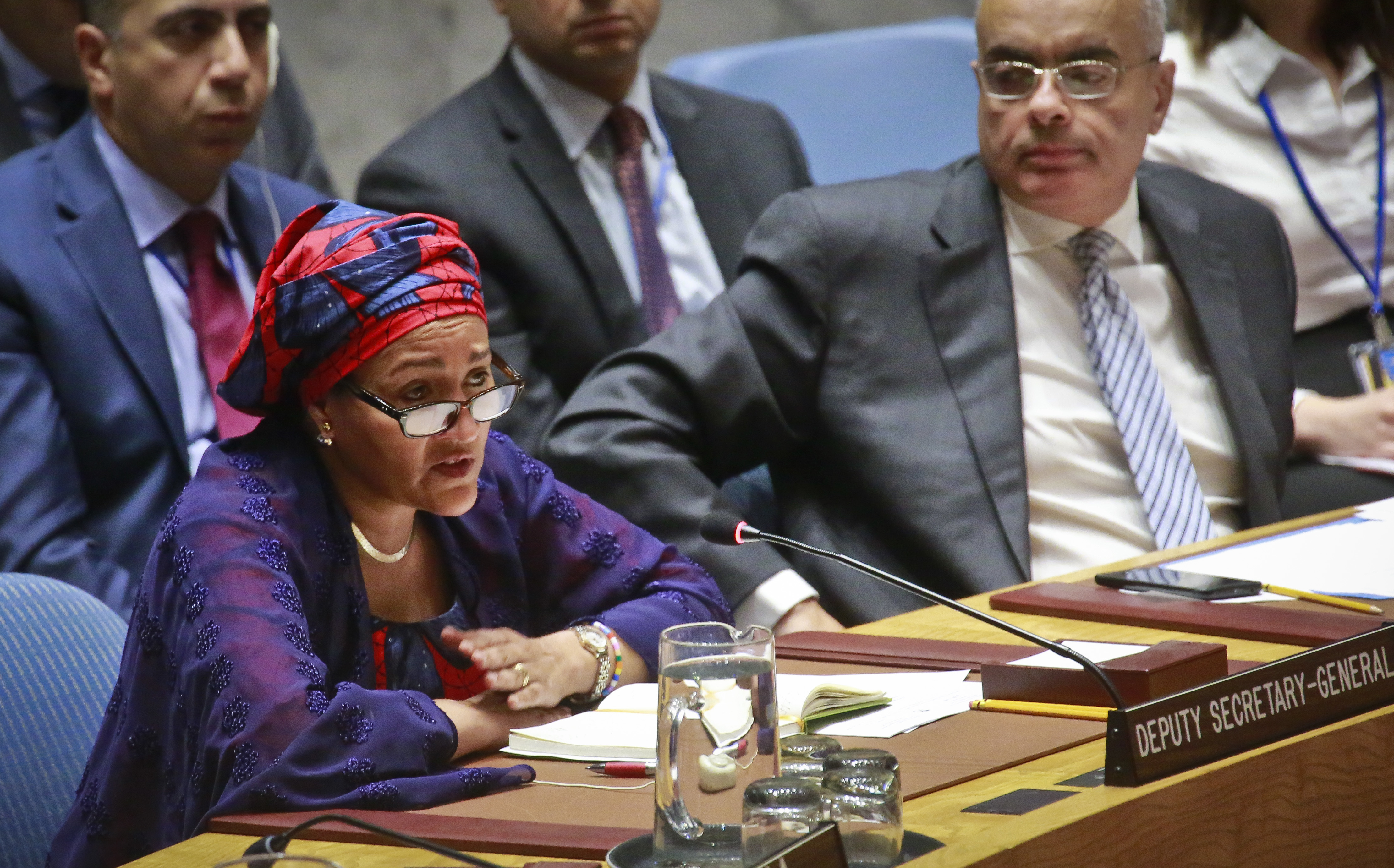 FILE - United Nations Deputy Secretary-General Amina Mohammed, left, addresses the Security Council meeting on peace and security in Africa, Aug. 10, 2017, at U.N. headquarters.