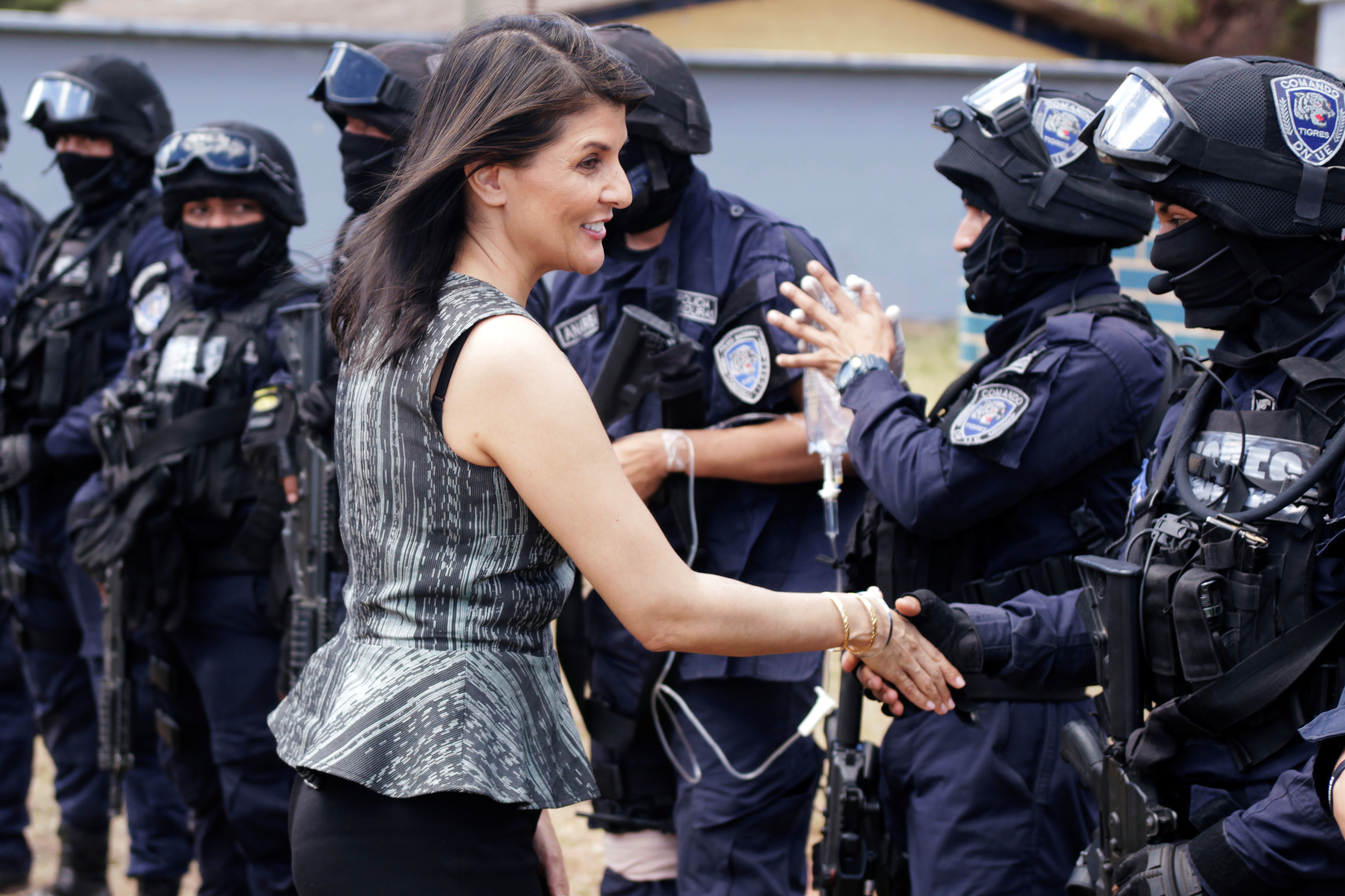 U.S. Ambassador to the United Nations Nikki Haley shakes hands with members of the COBRAS, Honduras National Police Special Forces, at their base in Tegucigalpa, Feb. 27, 2018.
