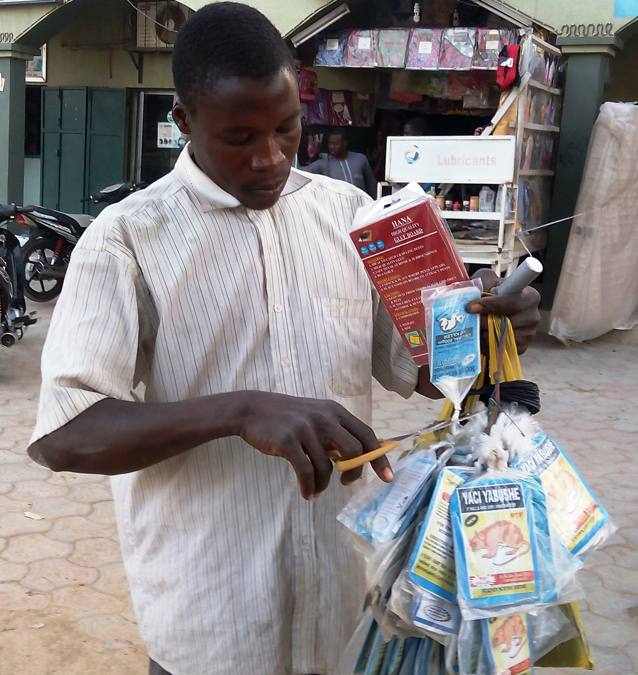 A vendor sells bags of rat poison in northern Nigeria's largest city of Kano, Jan. 18, 2016.