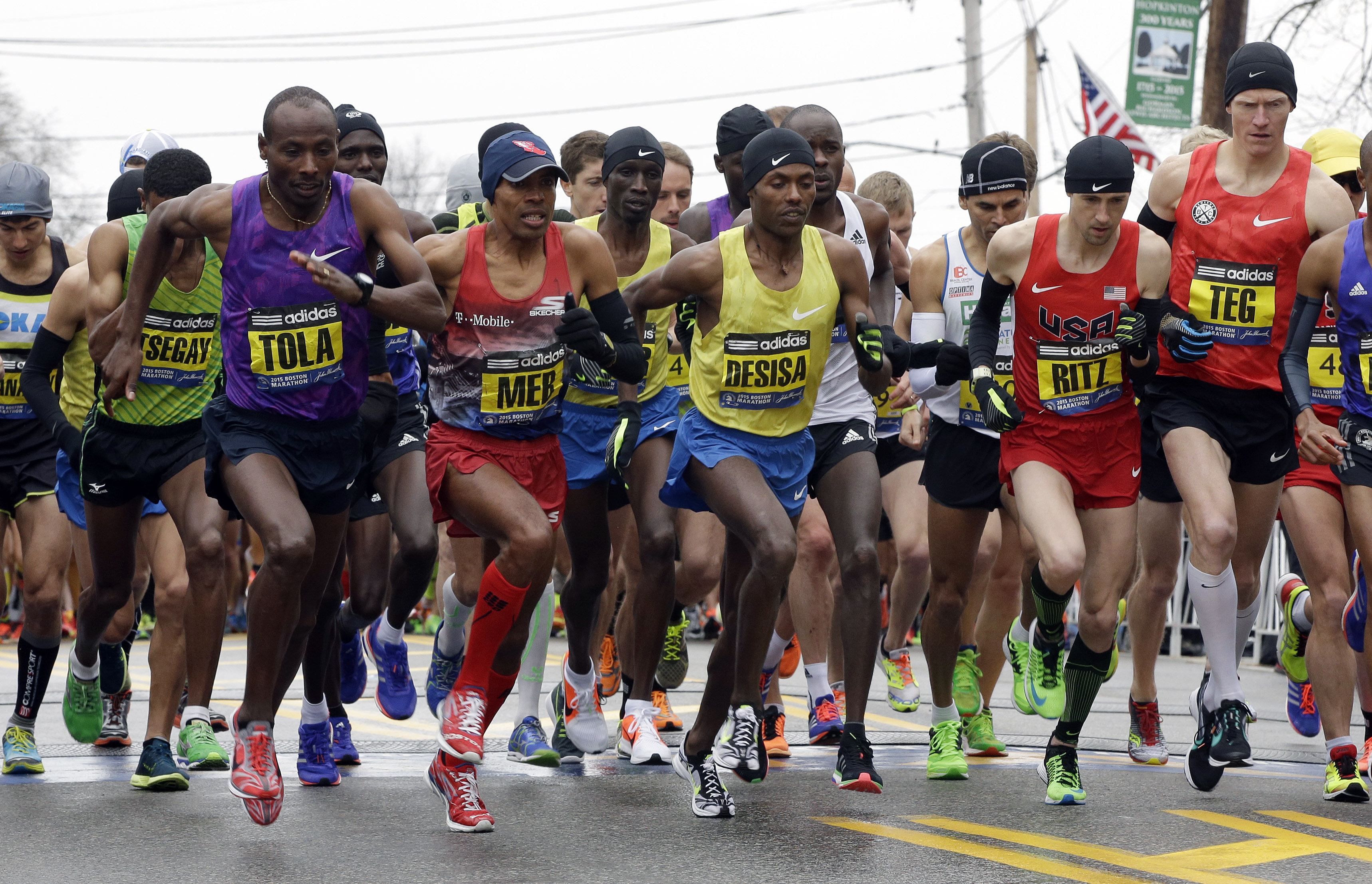 From left, Yemane Adhane Tsegay of Ethiopia, Tadese Tola of Ethiopia, Meb Keflezighi of San Diego, Lelisa Desisa of Ethiopia, Danthan Ritzenhein, of Rockford, Mich., and Matt Tegenkamp of Portland, Ore, leave the start line of the Boston Marathon  Ap...