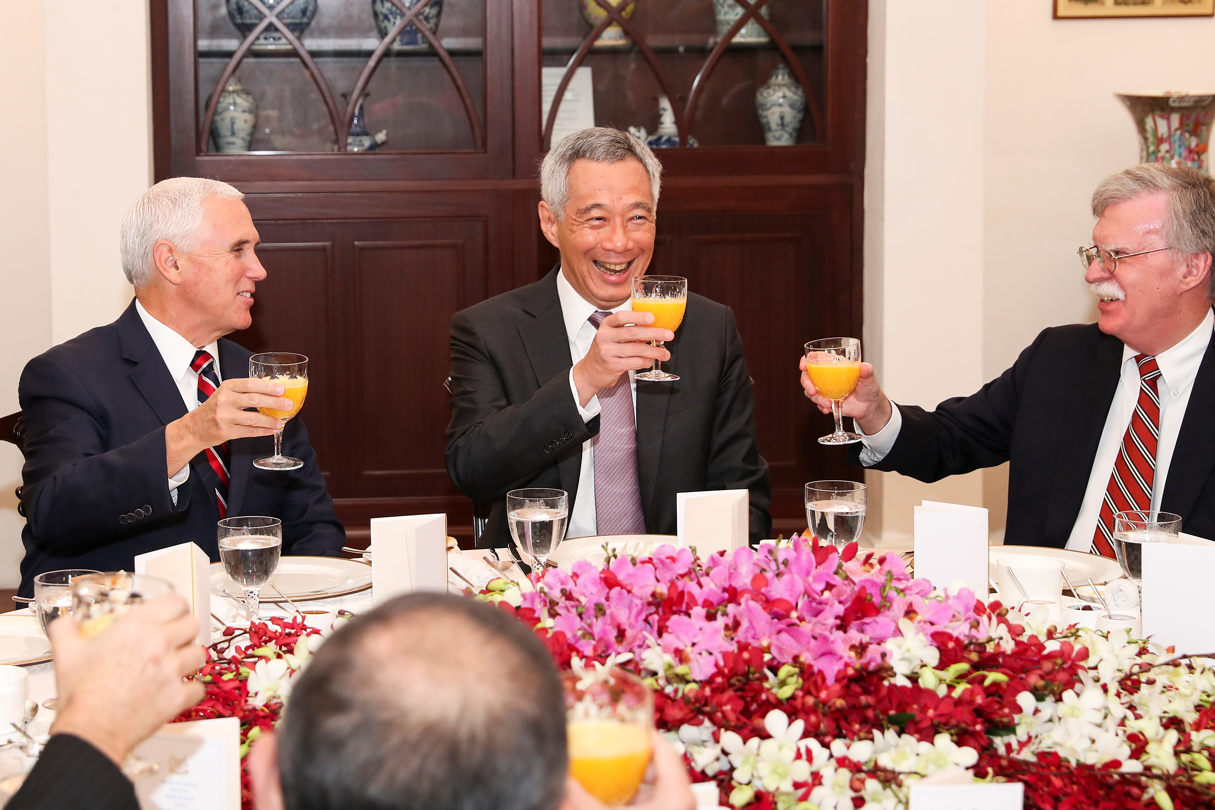 U.S. Vice President Mike Pence, left, and U.S. National security adviser John Bolton, right, attend a working breakfast hosted by Singaporean Prime Minister Lee Hsien Loong at the Istana, or Presidential Palace, in Singapore, Nov. 16, 2018.