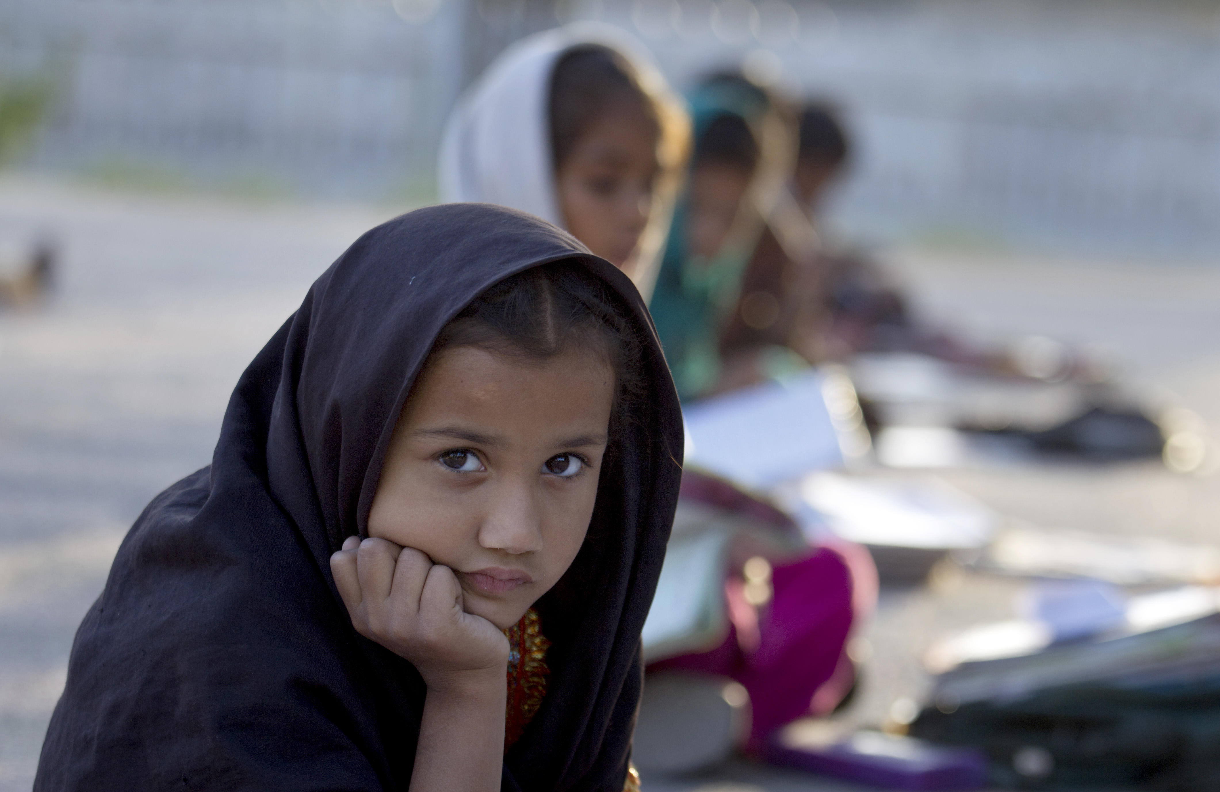 Pakistani student Farah Muneeb sits with other students at a makeshift school set up by a volunteer in a park in Islamabad, Pakistan on Thursday, Oct 11, 2012.