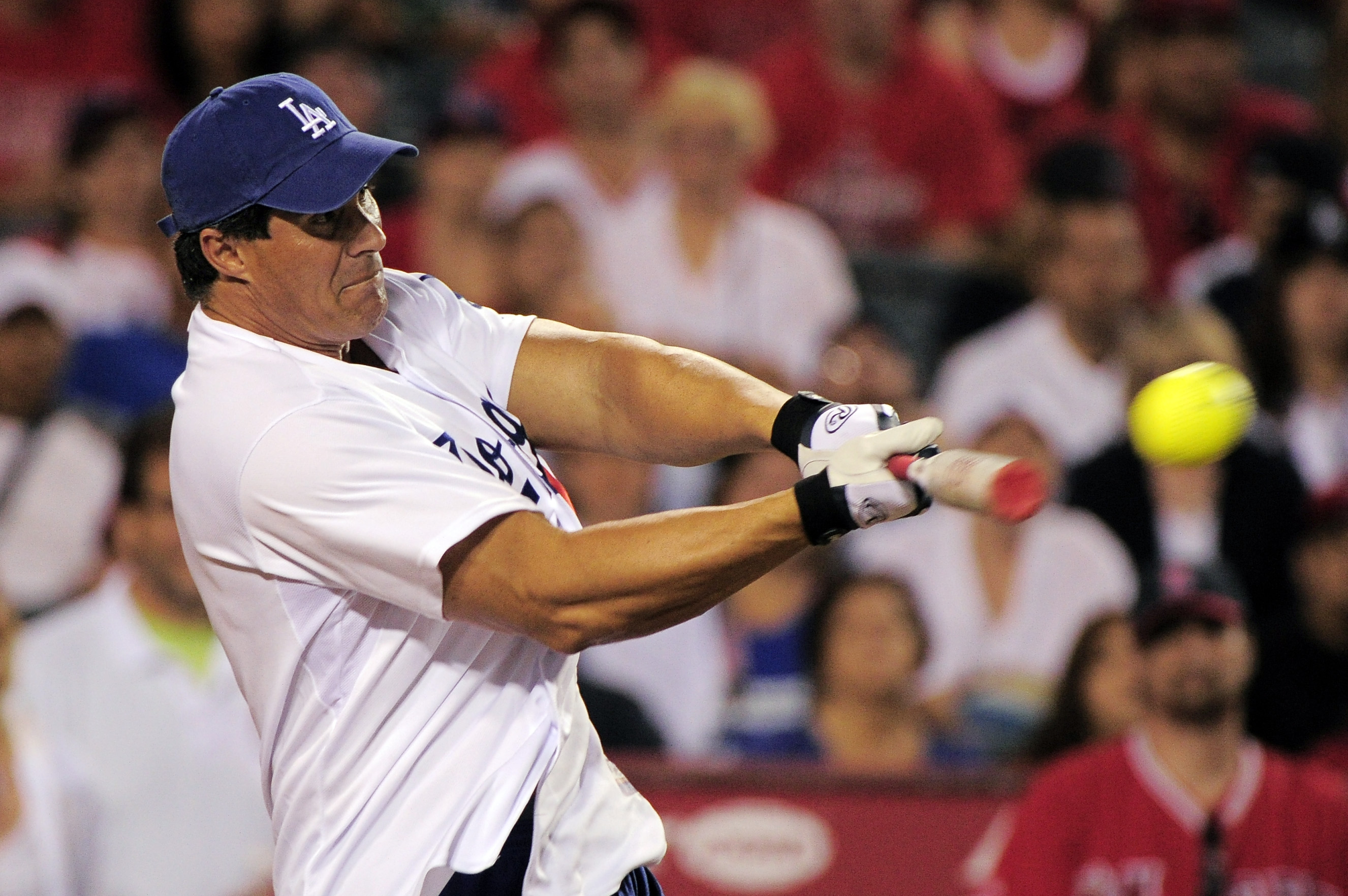 FILE - Former major leaguer Jose Canseco hits during a home run derby against former Los Angeles Angels' Tim Salmon, in Anaheim, Calif., July 3, 2011.