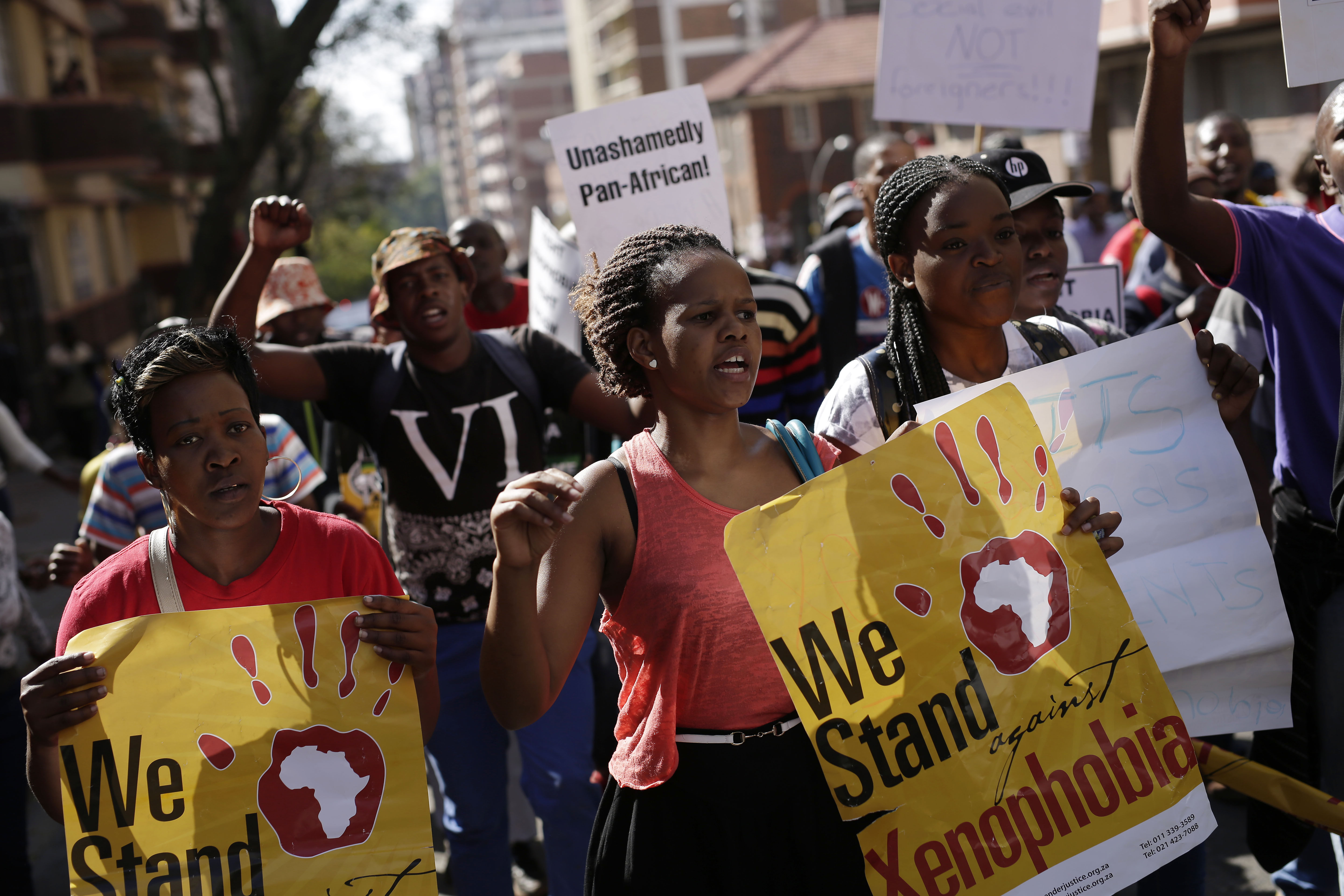 FILE - People rally during a march against xenophobia, in downtown Johannesburg, South Africa, 2015. Anti-foreigner sentiments have been on the rise in the country which, according to most recent data, is home to some two million foreign nationals.