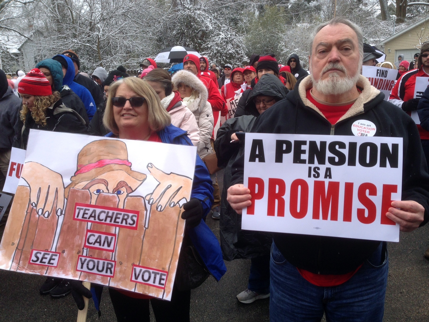 Debbie Burke, left, an elementary school teacher in Pike County, and her husband Gary Burke rally against a proposed pension overhaul bill, in Frankfort, Ky., March 21, 2018.