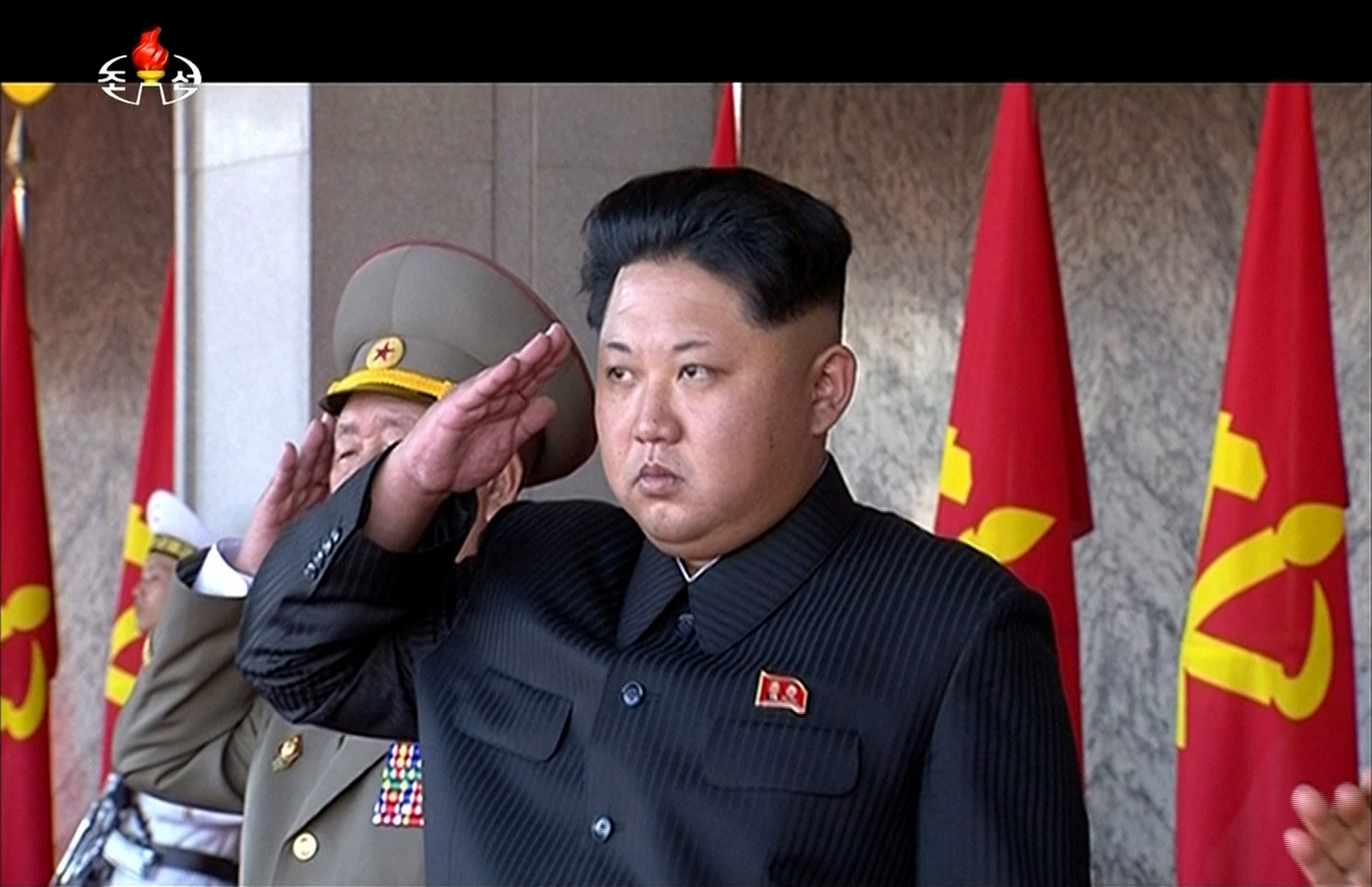 In this image made from video, North Korean leader Kim Jong Un salutes during the ceremony to mark the 70th anniversary of the country's ruling party in Pyongyang, Oct. 10, 2015.