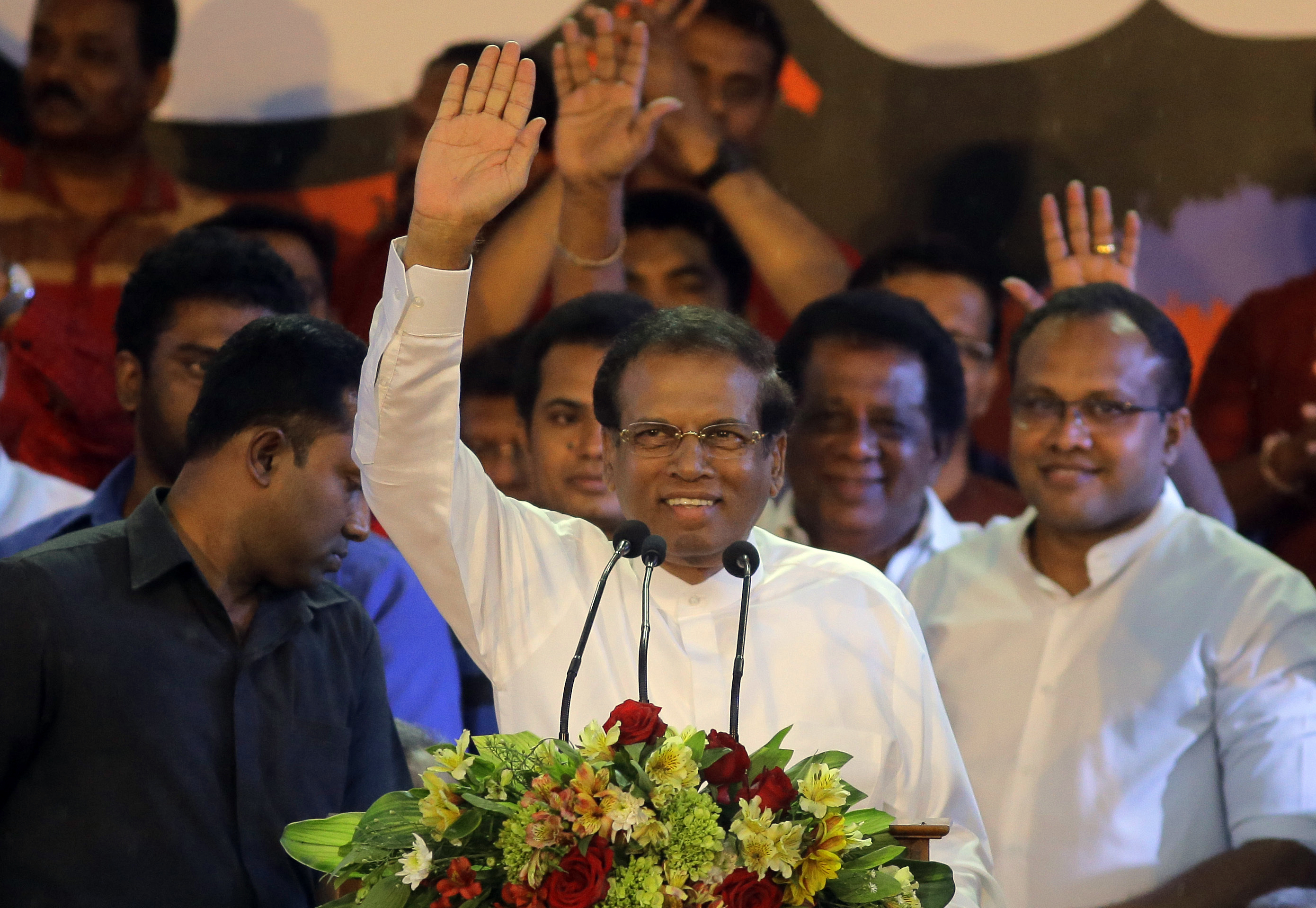 FILE - Sri Lankan President Maithripala Sirisena waves to supporters during a rally outside the parliamentary complex in Colombo, Sri Lanka, Nov. 5, 2018.