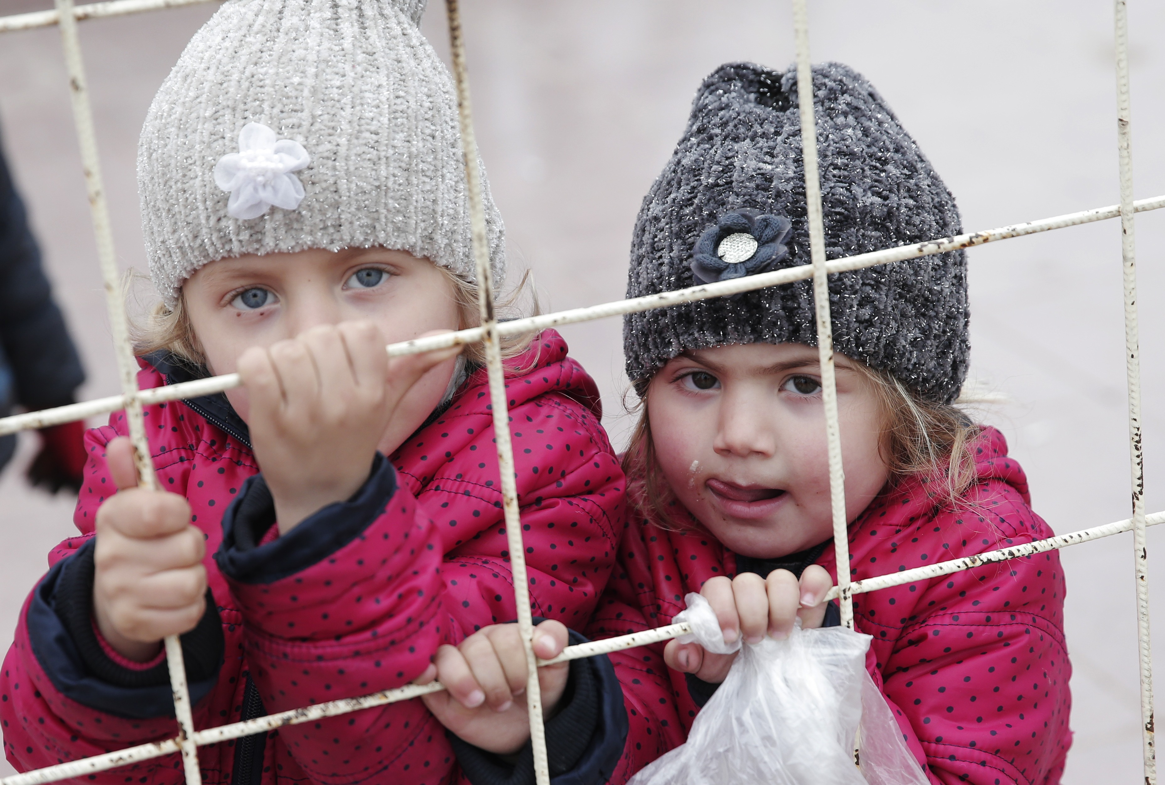 Syrian children wait to return to their country at the Turkish border crossing with Syria in the outskirts of Kilis, southeastern Turkey, Feb. 11, 2016.