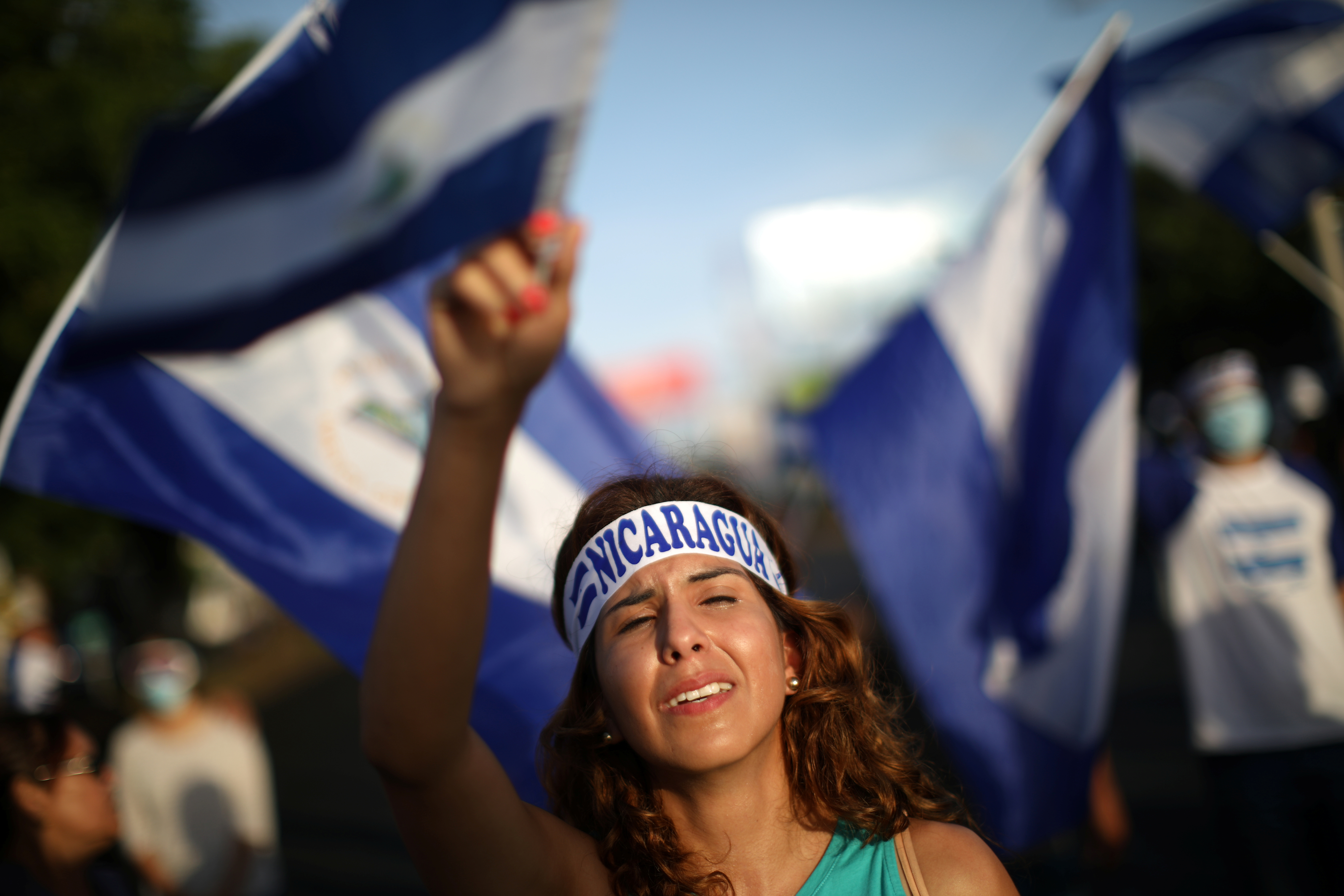 A demonstrator cries as she sings a song during a protest in Managua, Nicaragua, June 18, 2018.