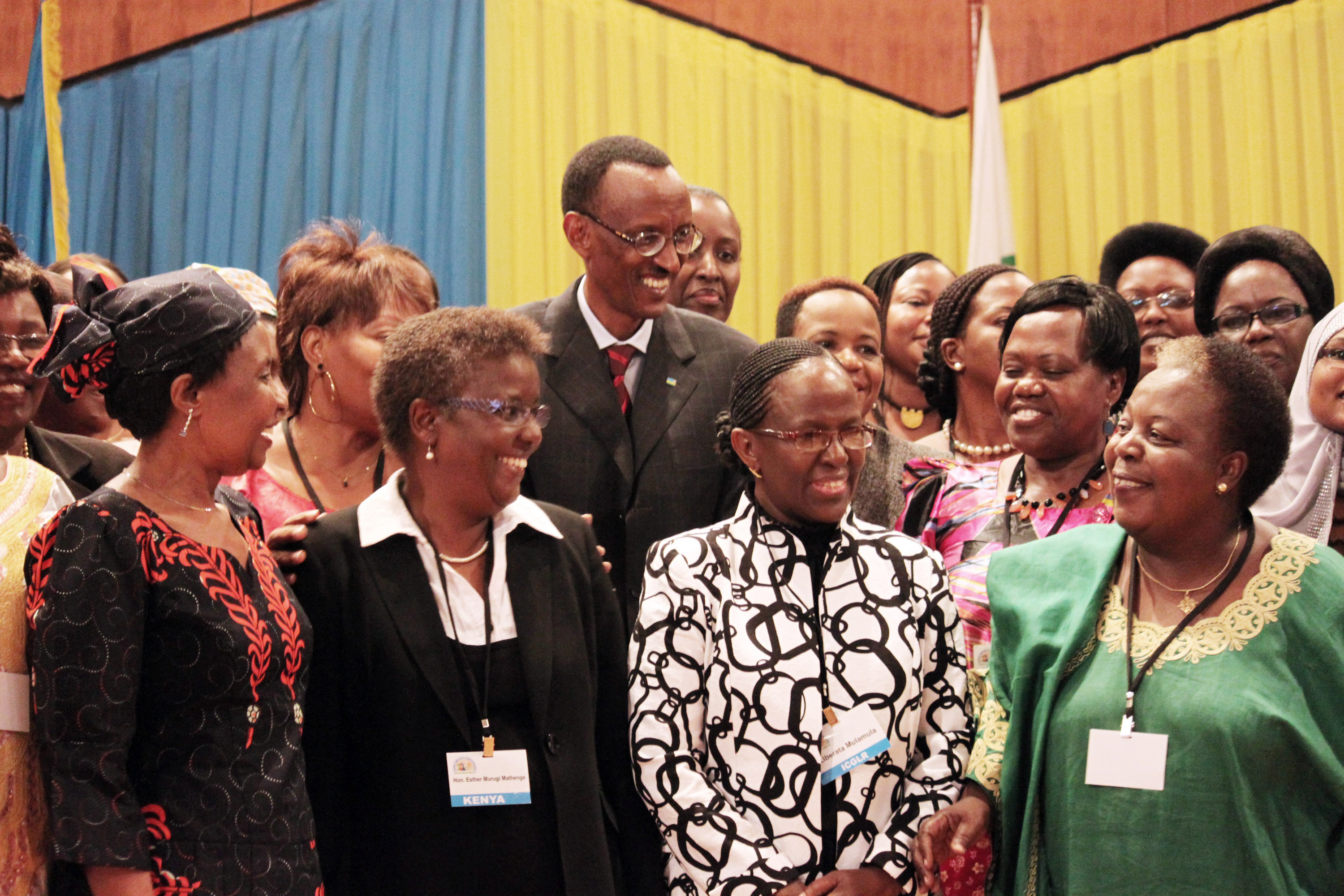 FILE - Rwandan President Paul Kagame, centre, takes part in a group photo at a conference on the role of women at the nation's parliament, May 17, 2010.