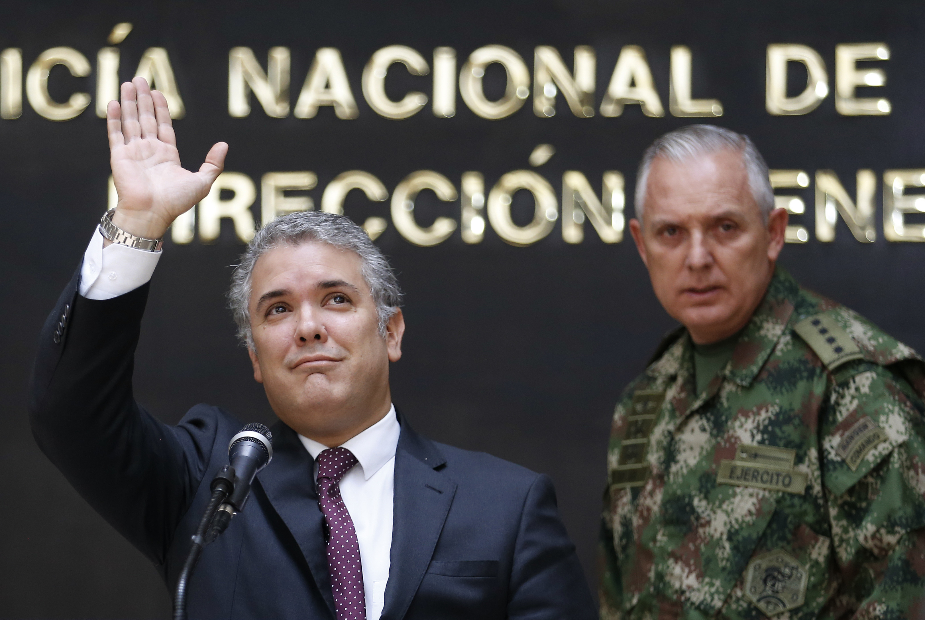 Colombia's President Ivan Duque, left, stands next to the Commander of the Armed Forces Gen. Alberto Mejia, at police headquarters in Bogota, Colombia, Sept. 19, 2018. Duque said Saturday the armed forces had killed a dissident rebel of the disbanded...