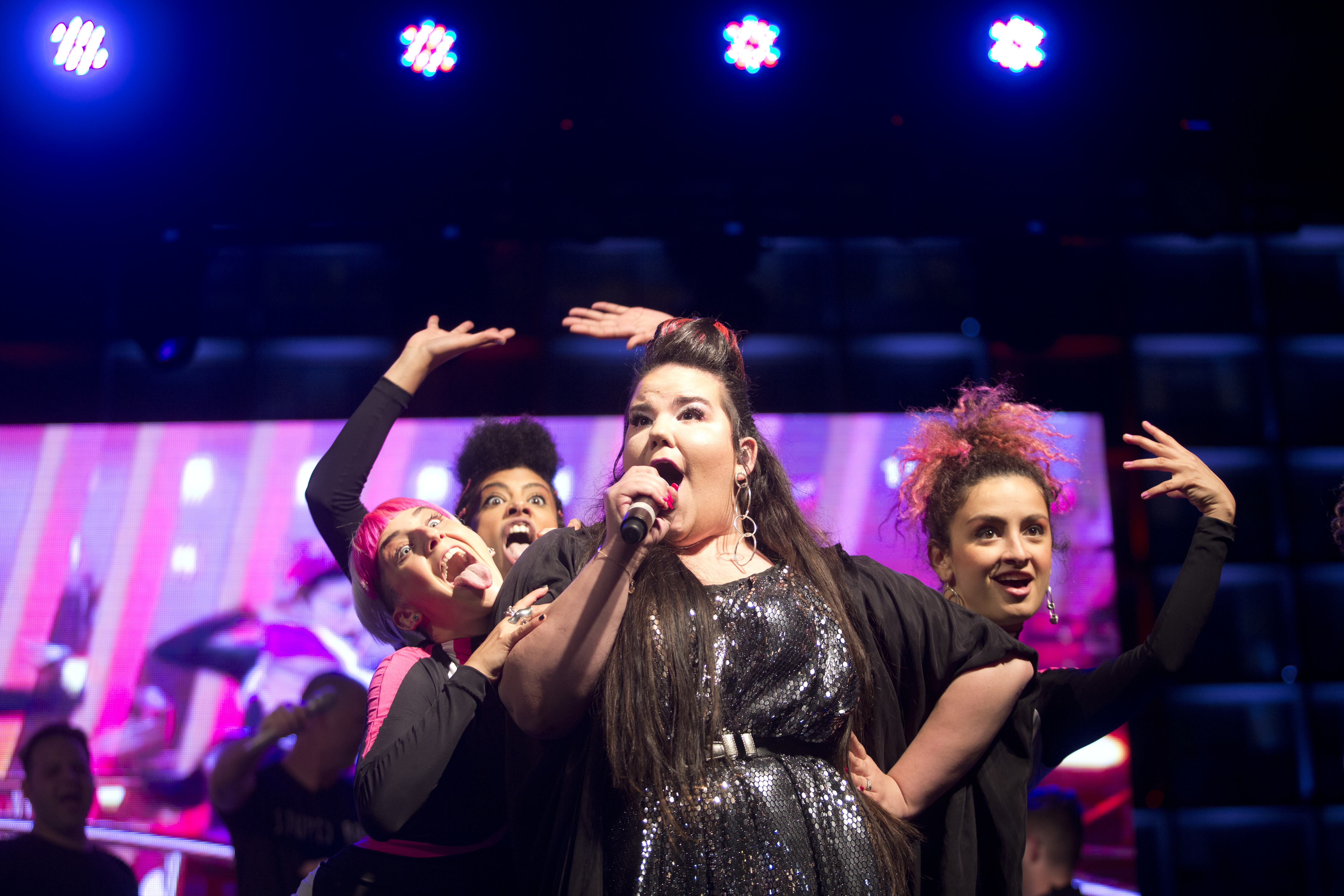 Israeli singer Netta Barzilai, center, who won the 2018 Eurovision song contest, performs at Rabin Square in Tel Aviv, Israel, May 14, 2018.