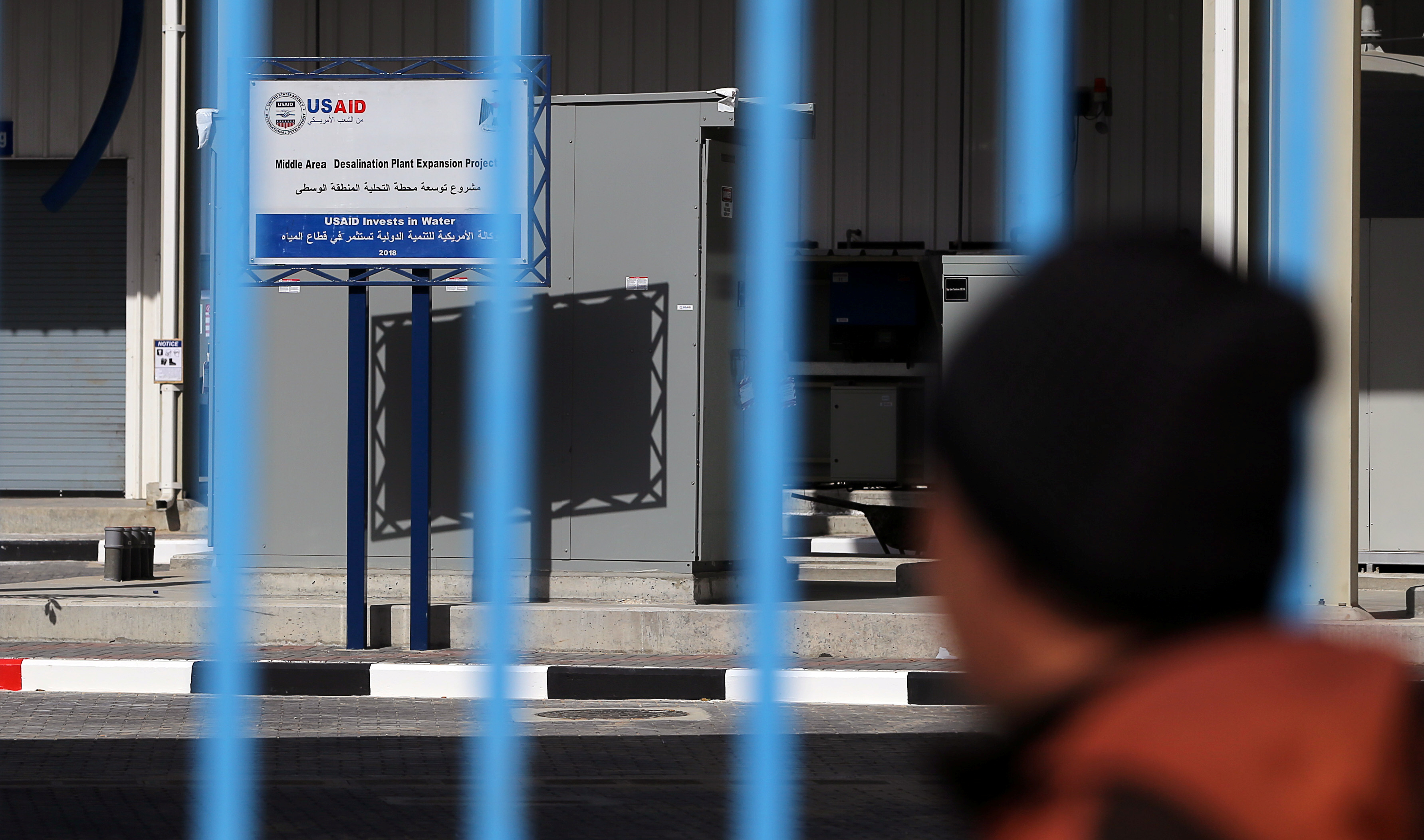 A sign of the U.S. Agency for International Development (USAID) is seen at a water desalination plant in the central Gaza Strip, Feb. 1, 2019.