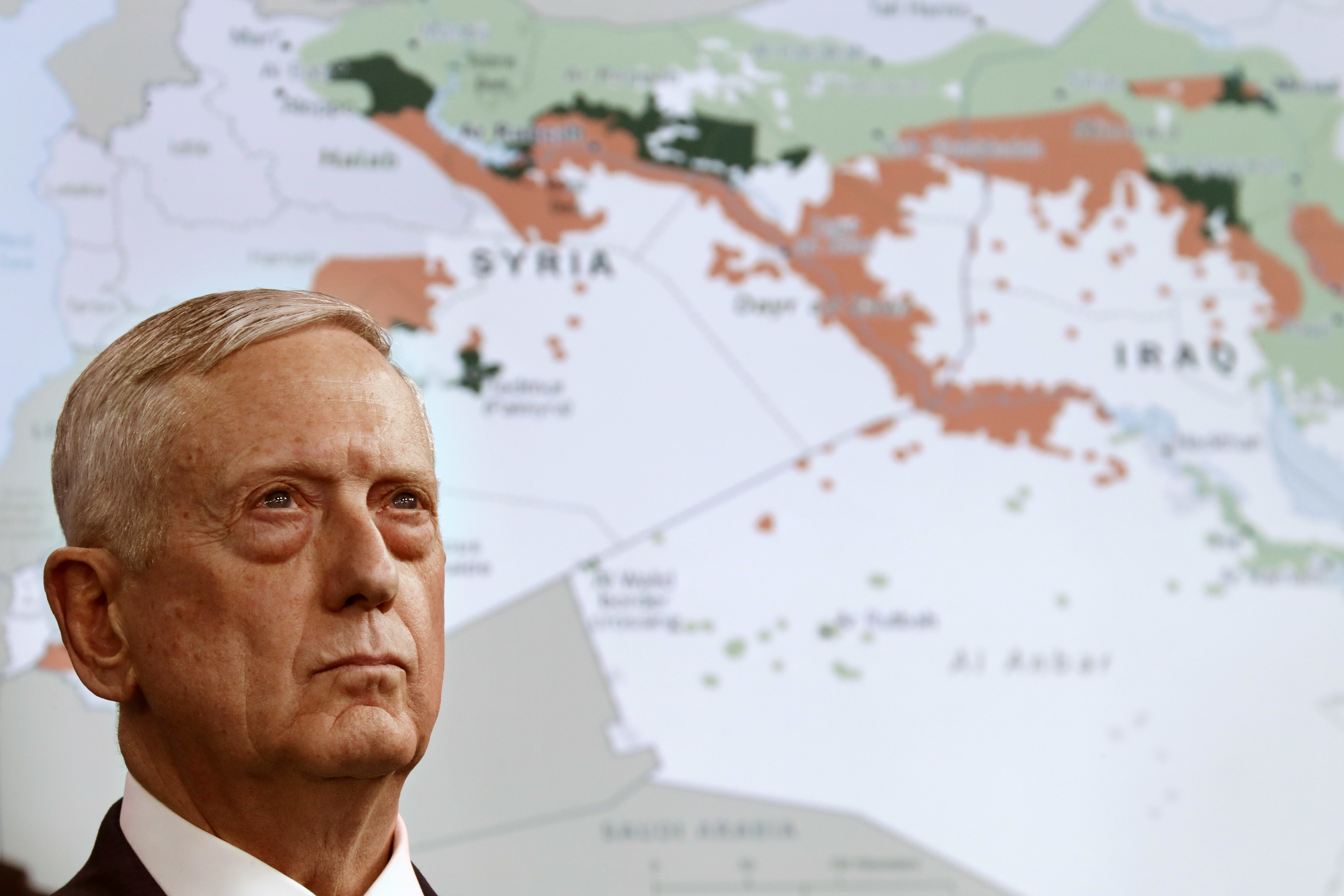 Secretary of Defense Jim Mattis stands in front of a map of Syria and Iraq, while speaking to the media about the Islamic State group at the Pentagon, May 19, 2017.