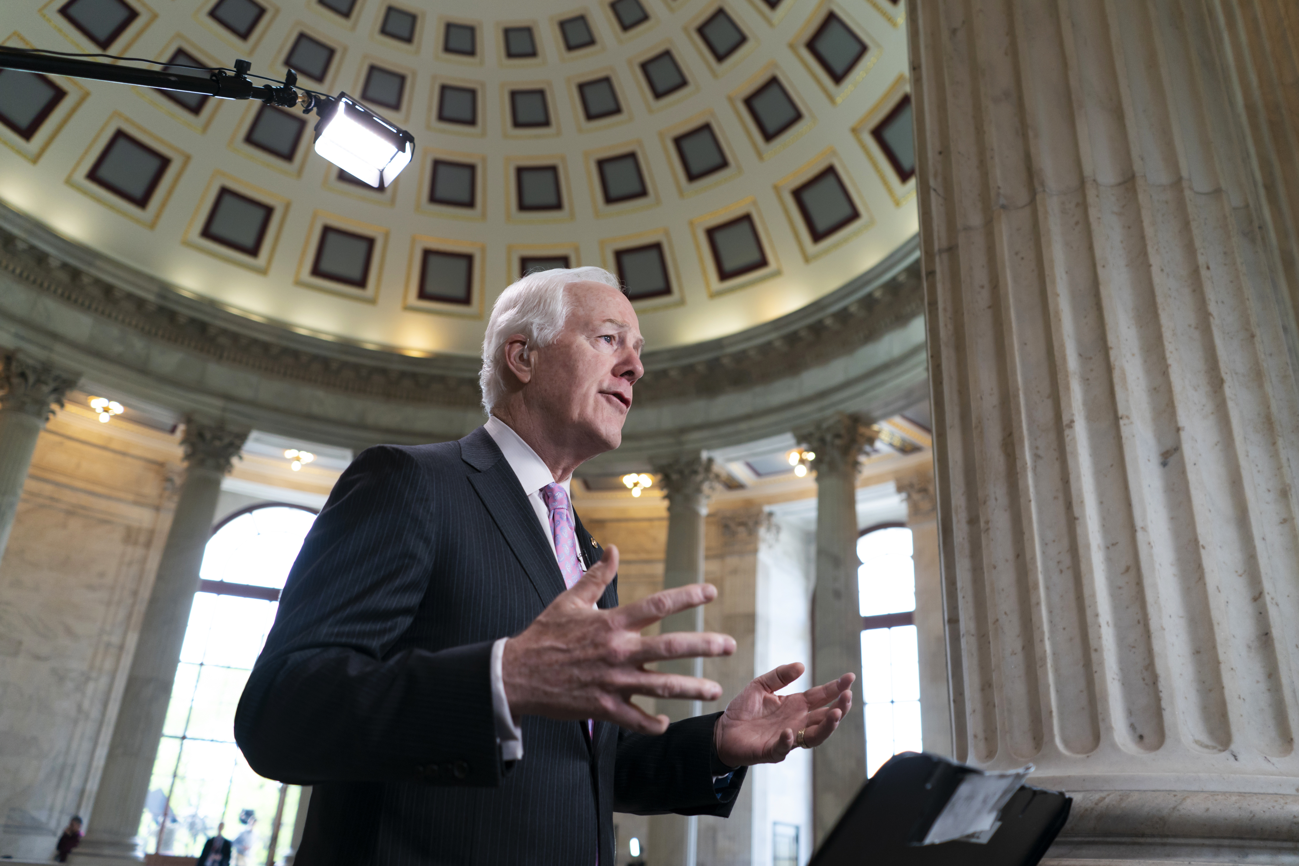 FILE - Majority Whip John Cornyn, R-Texas, takes questions during a TV news interview on Capitol Hill in Washington, April 26, 2018.