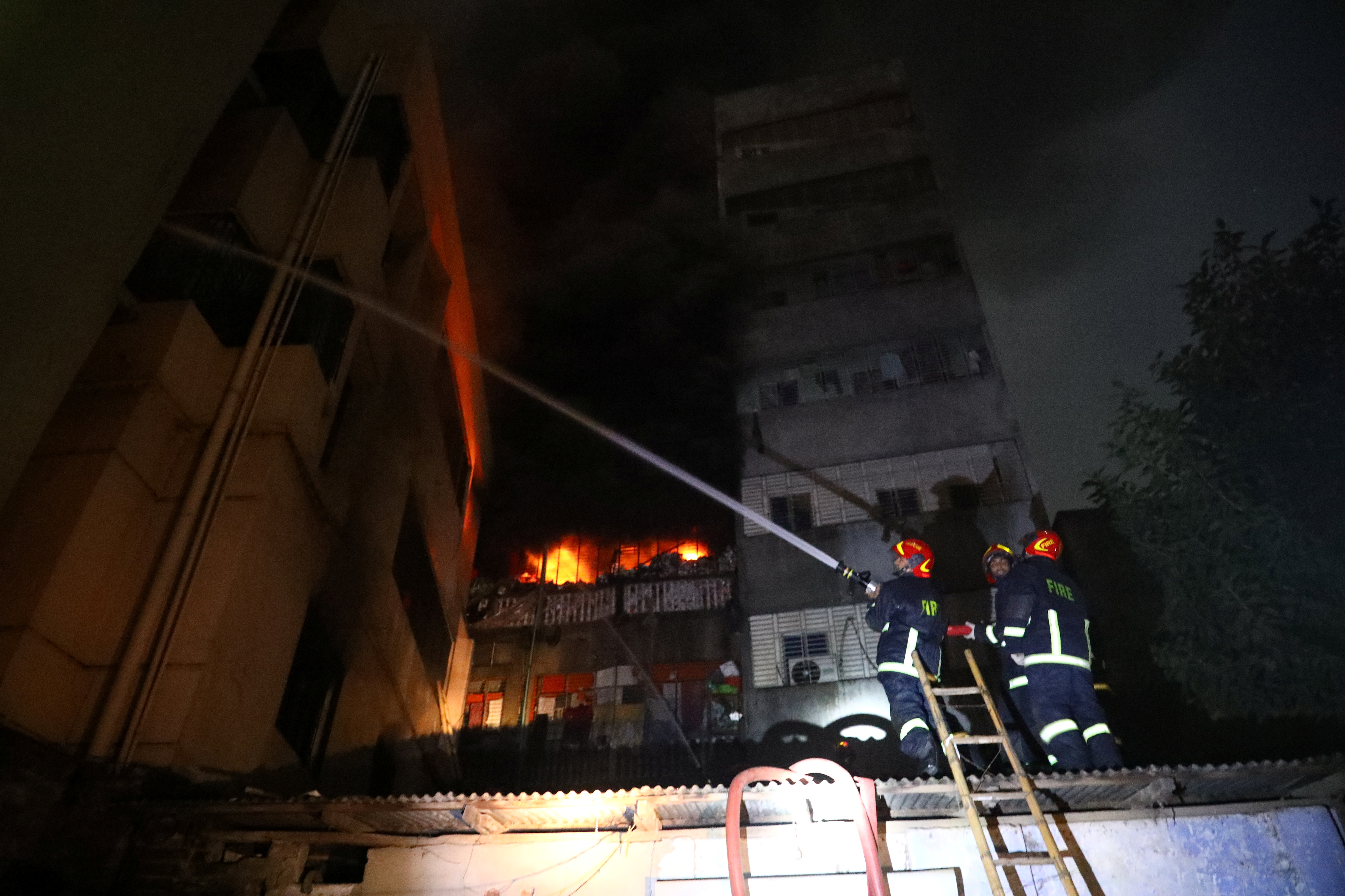 Firefighters work at the scene of a fire that broke out Feb. 20, 2019, at a chemical warehouse in Dhaka, Bangladesh.