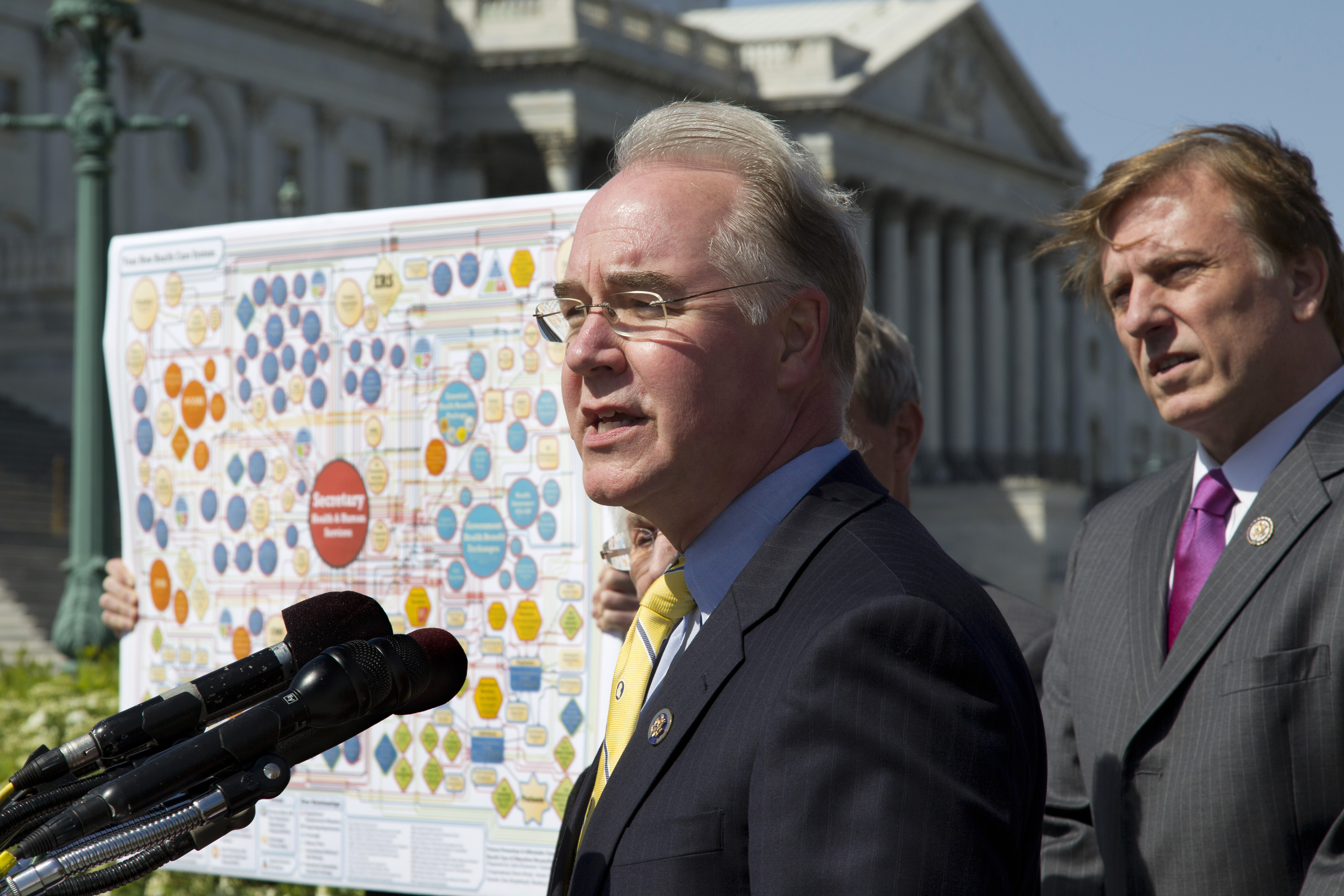 FILE - Rep. Tom Price, R-Ga., left, speaks during a news conference in Washington, March 26, 2012, to oppose the Affordable Care Act, often referred to as Obamacare.