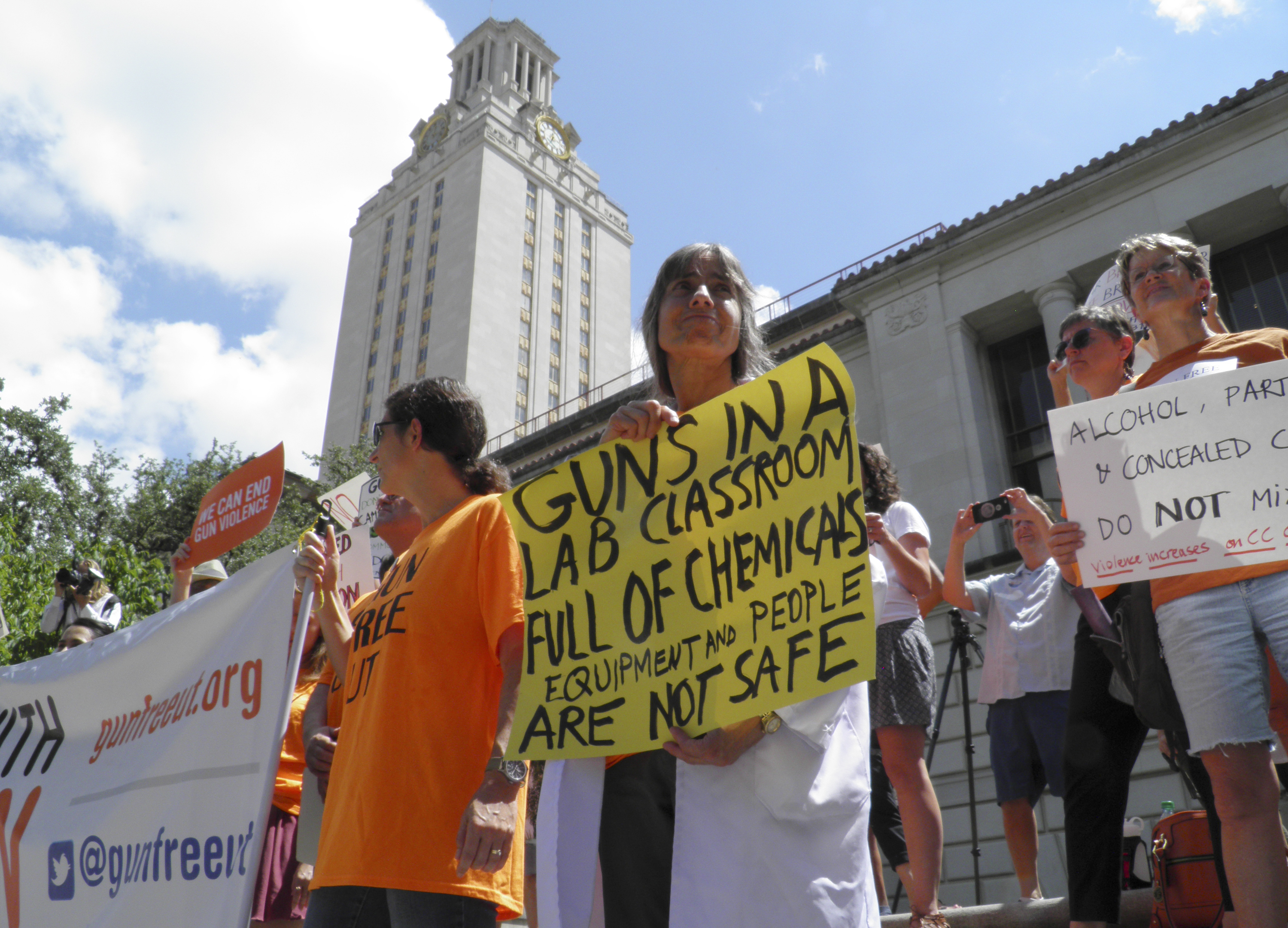 FILE - Faculty and staff at the University of Texas protest against a state law that allows for guns in classrooms at college campuses, in Austin, Texas, U.S. August 24, 2016.