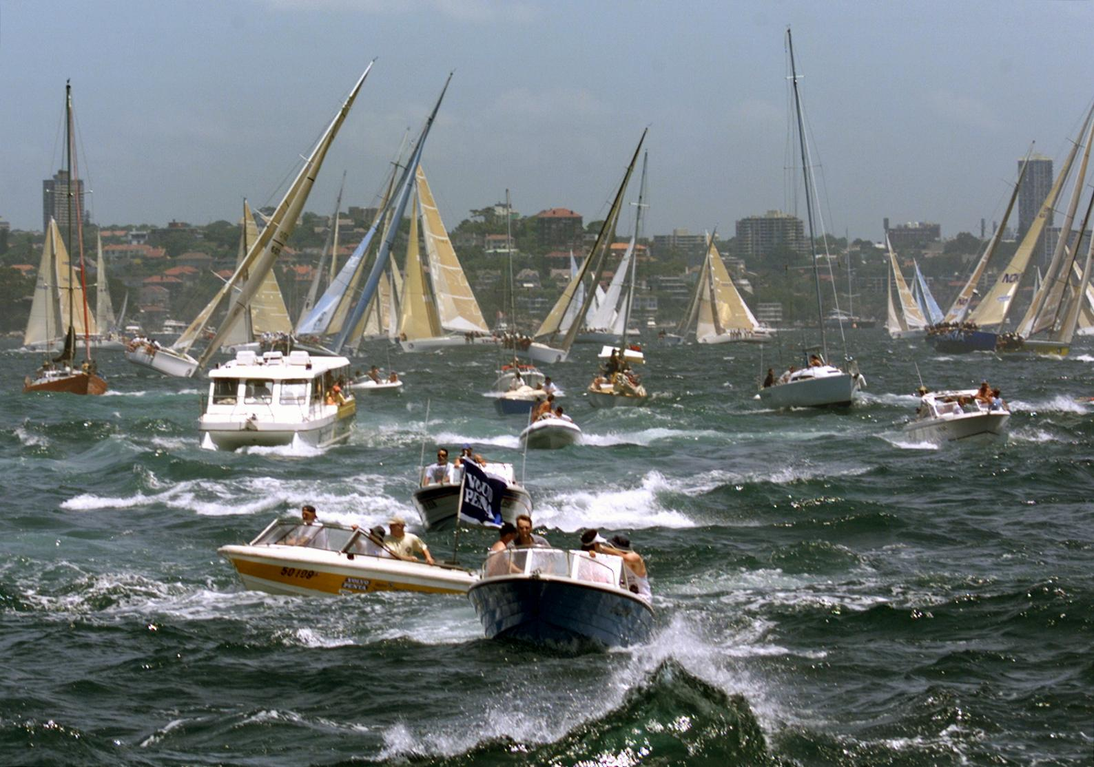 An armada of spectator craft churn up Sydney Harbour during the start of the 54th Sydney-to-Hobart ocean race, Dec. 26, 1998.