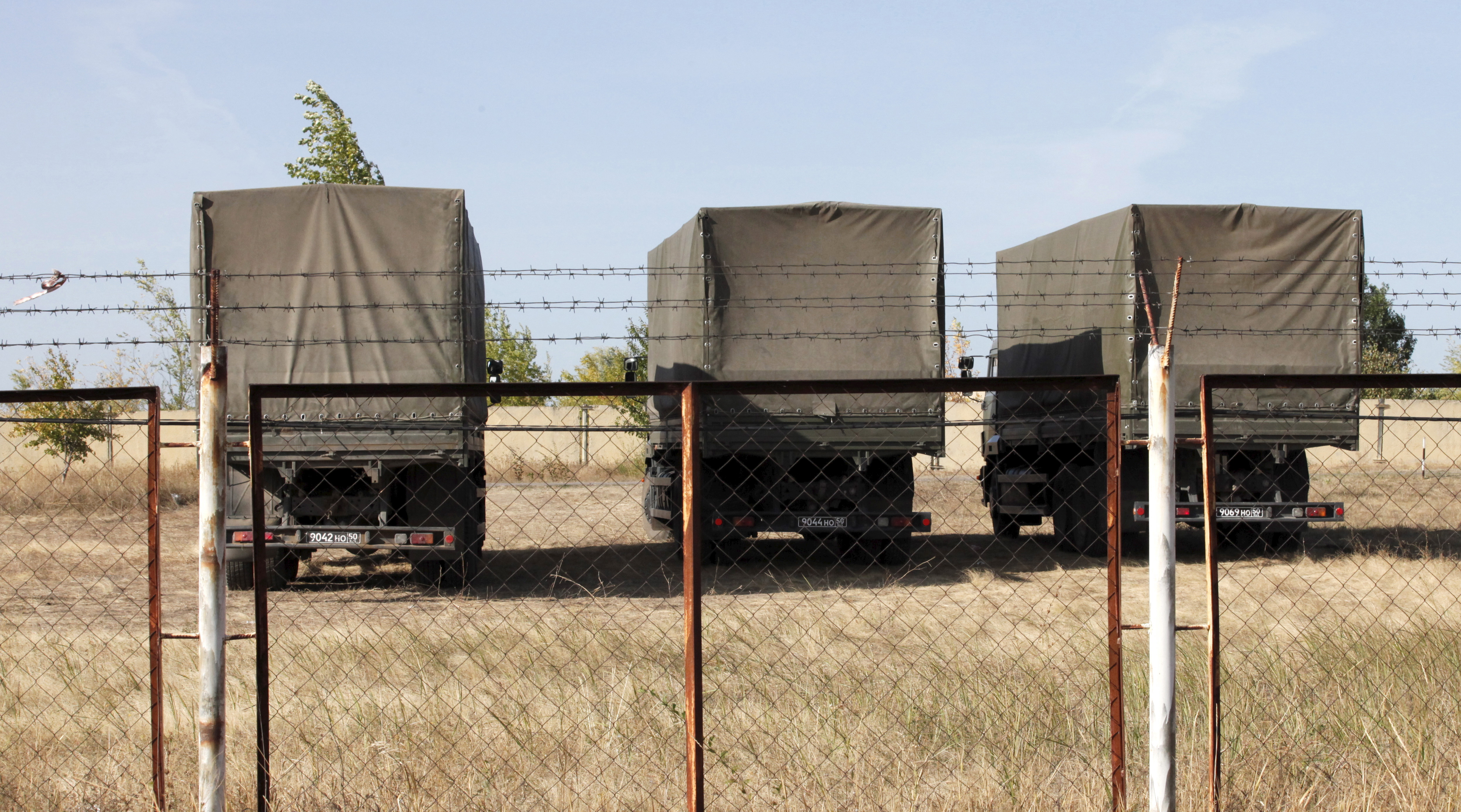 Russian military trucks are seen on the territory of an old military depot near the Russian-Ukrainian border in the town of Boguchar, south of Voronezh, Russia, Sept. 21, 2015.