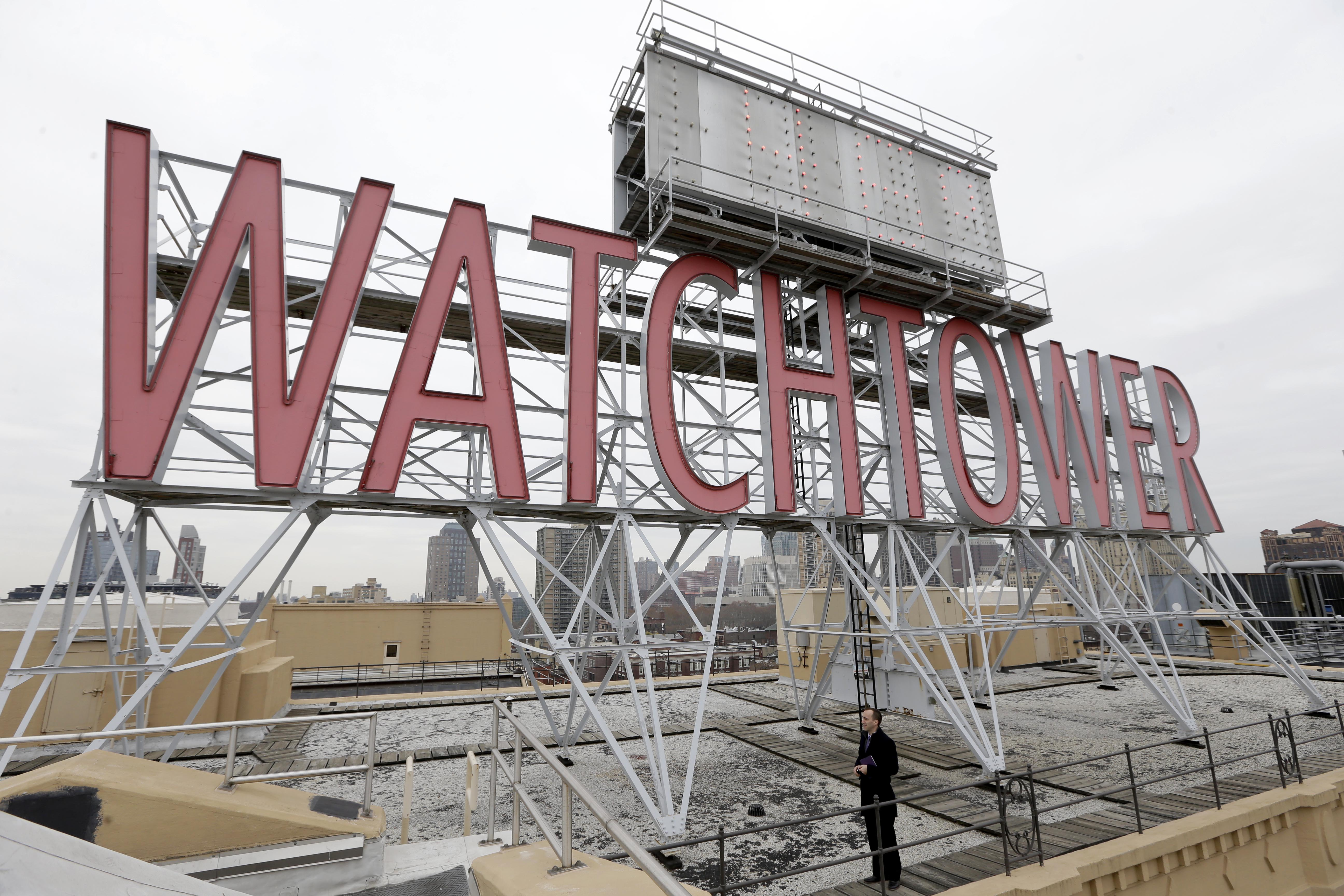 FILE - The iconic Watchtower sign is seen on the roof of 25-30 Columbia Heights, the current world headquarters of the Jehovah's Witnesses, in the Brooklyn borough of New York, Dec. 9, 2015.