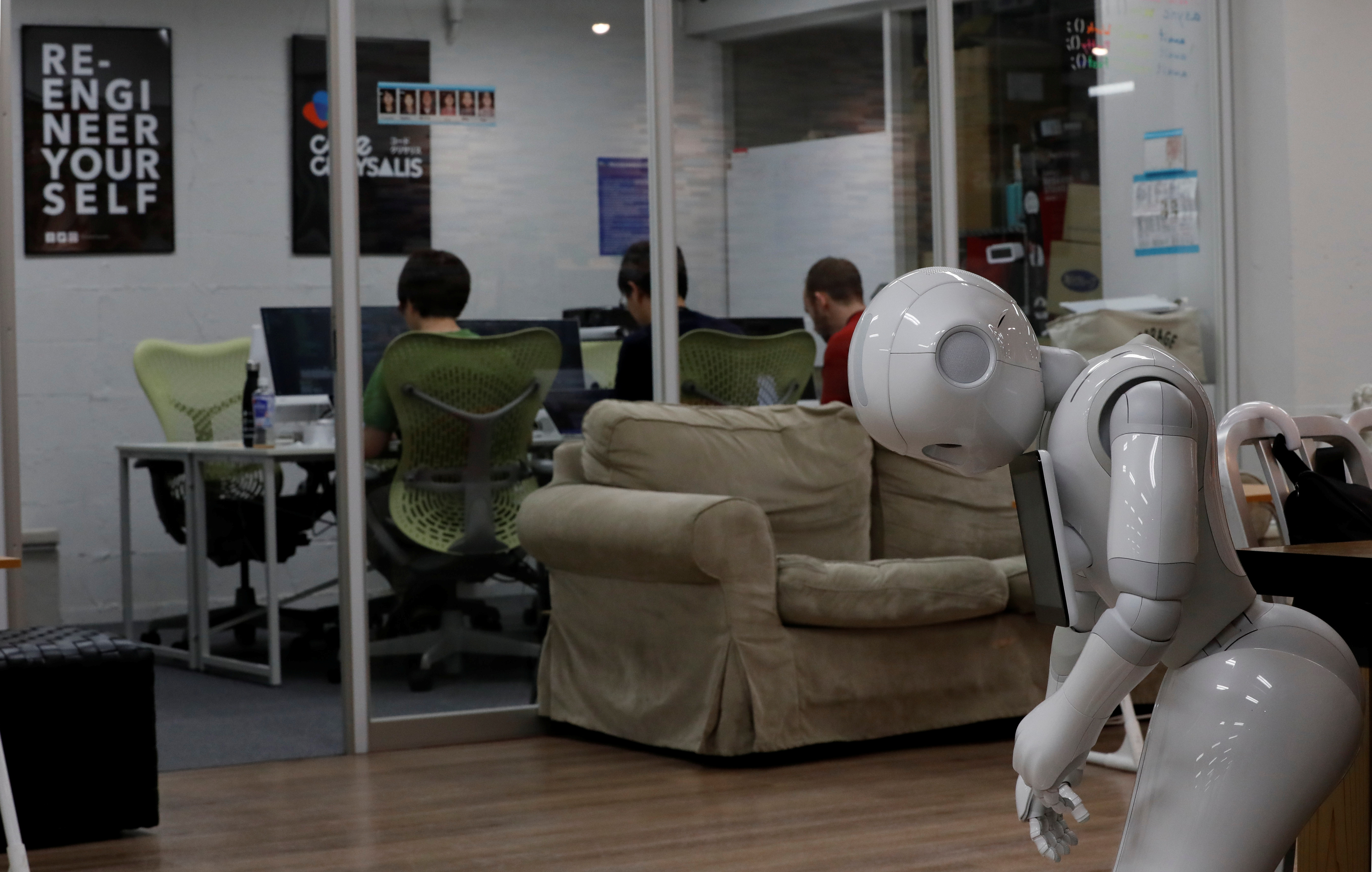 SoftBank's humanoid robots 'Pepper' is seen as students attend Code Chrysalis, a software-coding boot camp, at a basement room in Tokyo, Japan, May 23 2018.