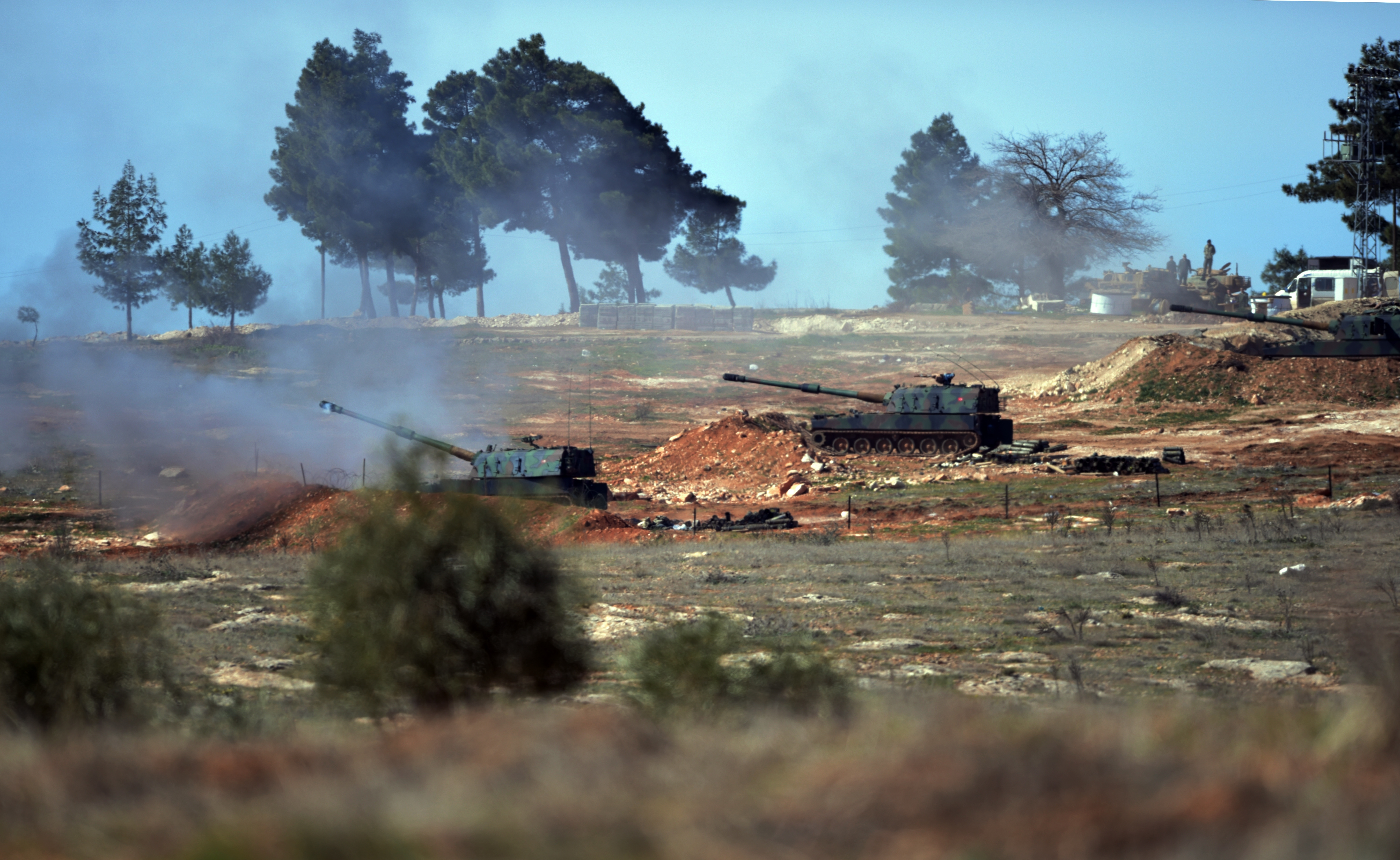 FILE - Turkish artillery fire from the border toward northern Syria, in Kilis, Turkey, Feb. 16, 2016.
