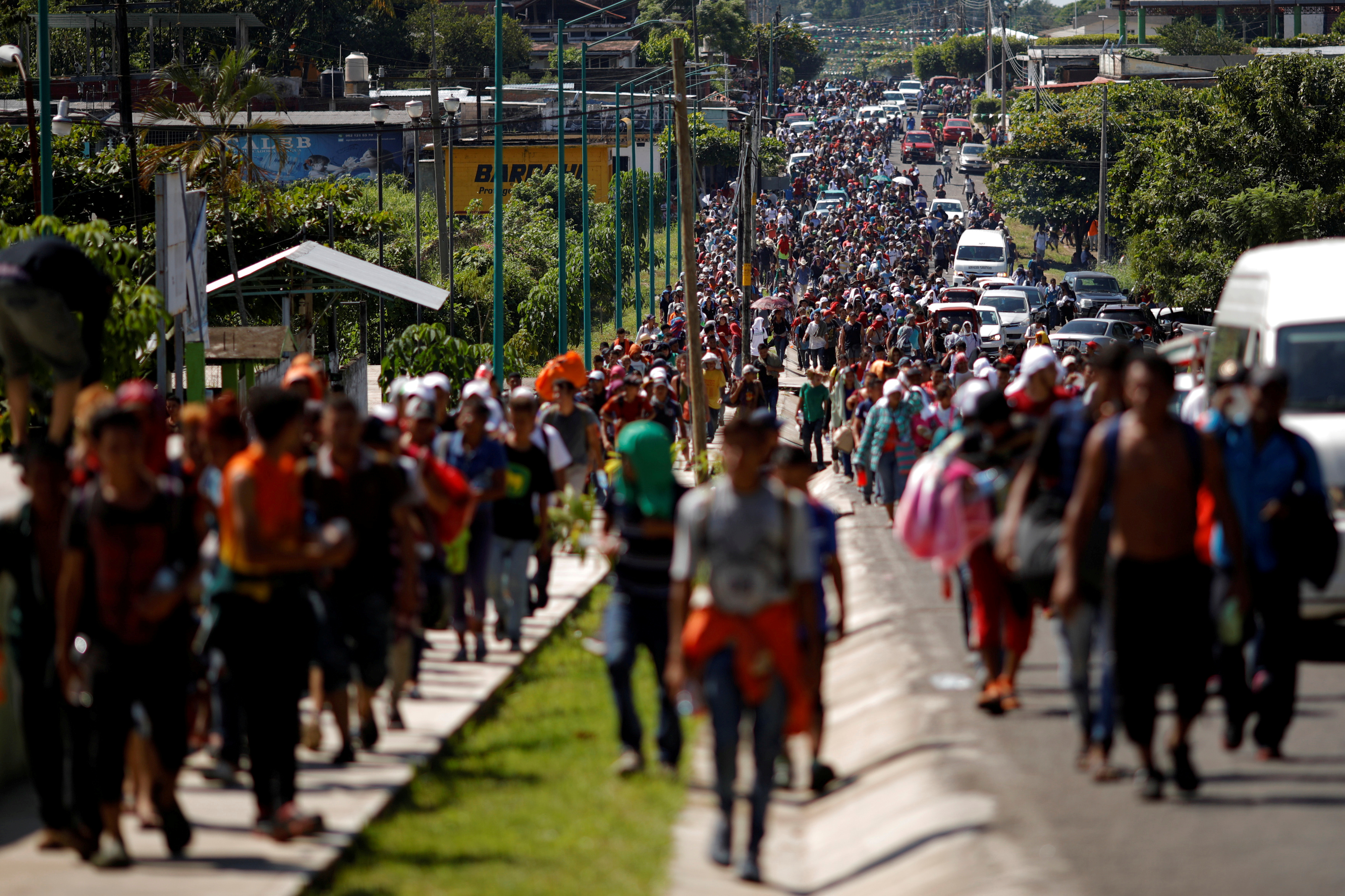 Central American migrants walk along the highway near the border with Guatemala, as they continue their journey trying to reach the U.S., in Tapachula, Mexico, Oct. 21, 2018.