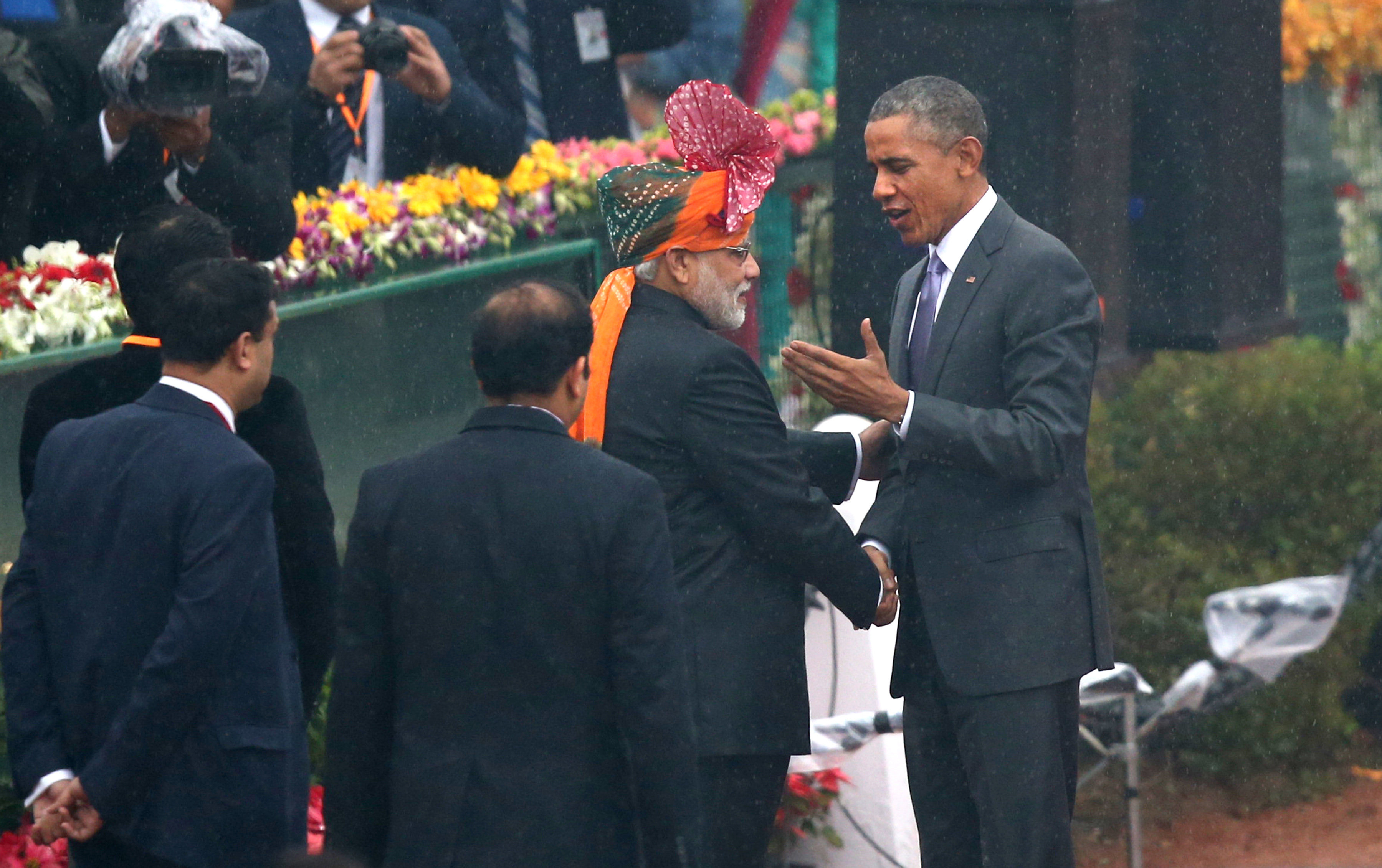 President Barack Obama shakes hand with Indian Prime Minister Narendra Modi as he arrives to preside over India's annual Republic Day parade in New Delhi, India, Monday, Jan. 26, 2015.