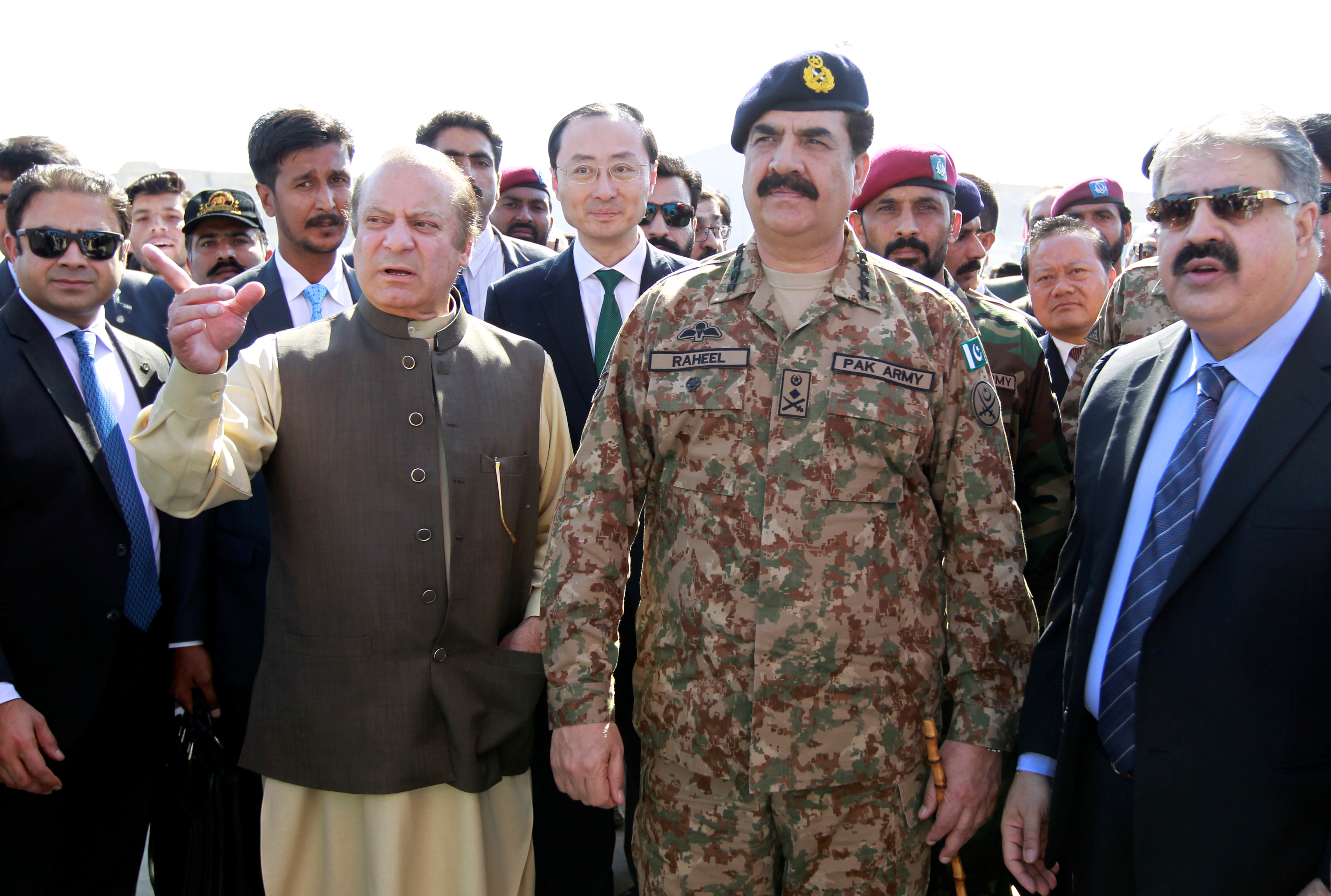In this Nov. 13, 2016 photo, Pakistan's Prime Minister Nawaz Sharif and Army Chief of Staff General Raheel Sharif attend the inauguration of  a port in Gwadar, Pakistan.