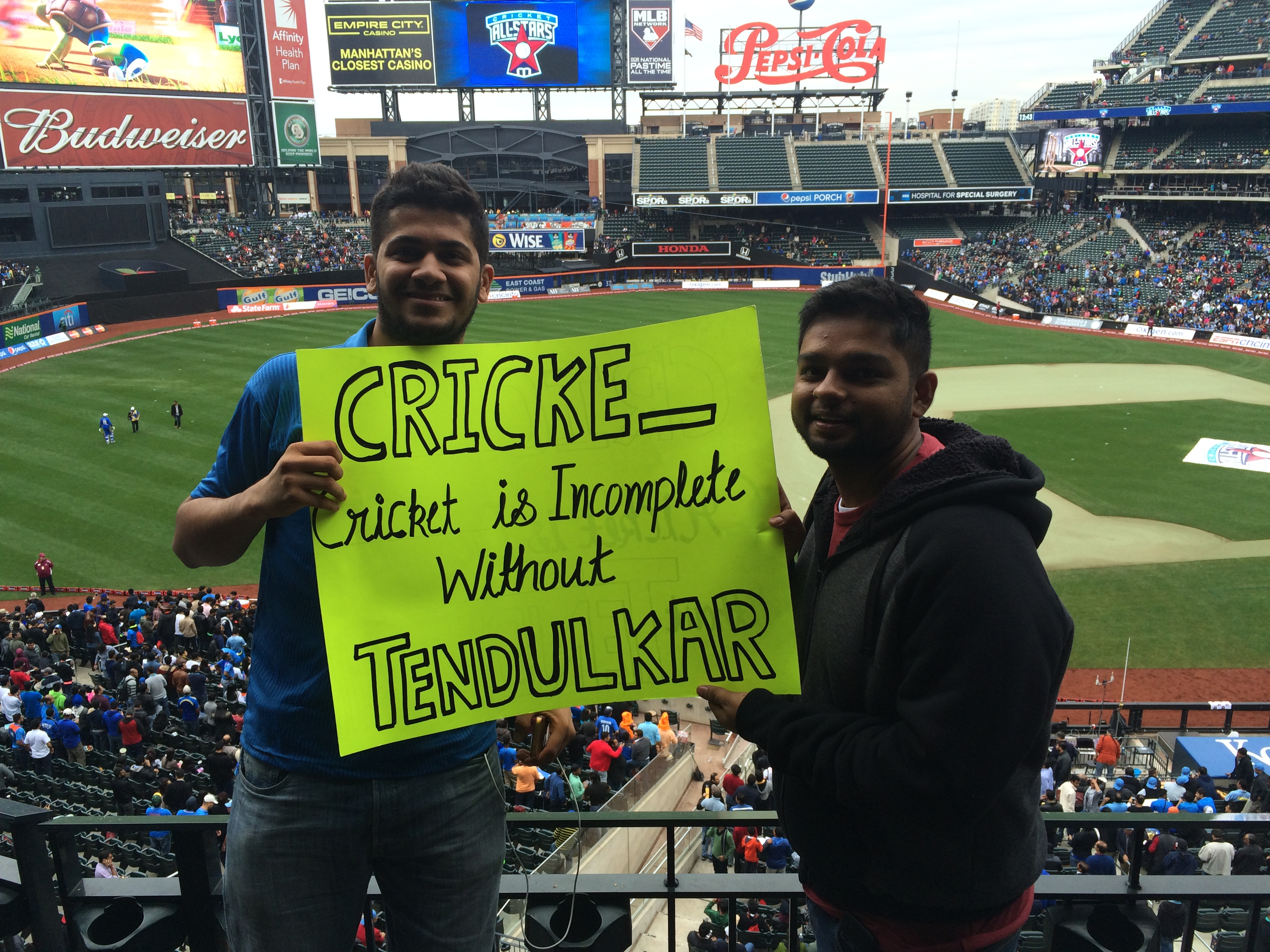 Cricket icon Sachin Tendulkar's fans holding a sign at Citi Field before the start of All Stars game