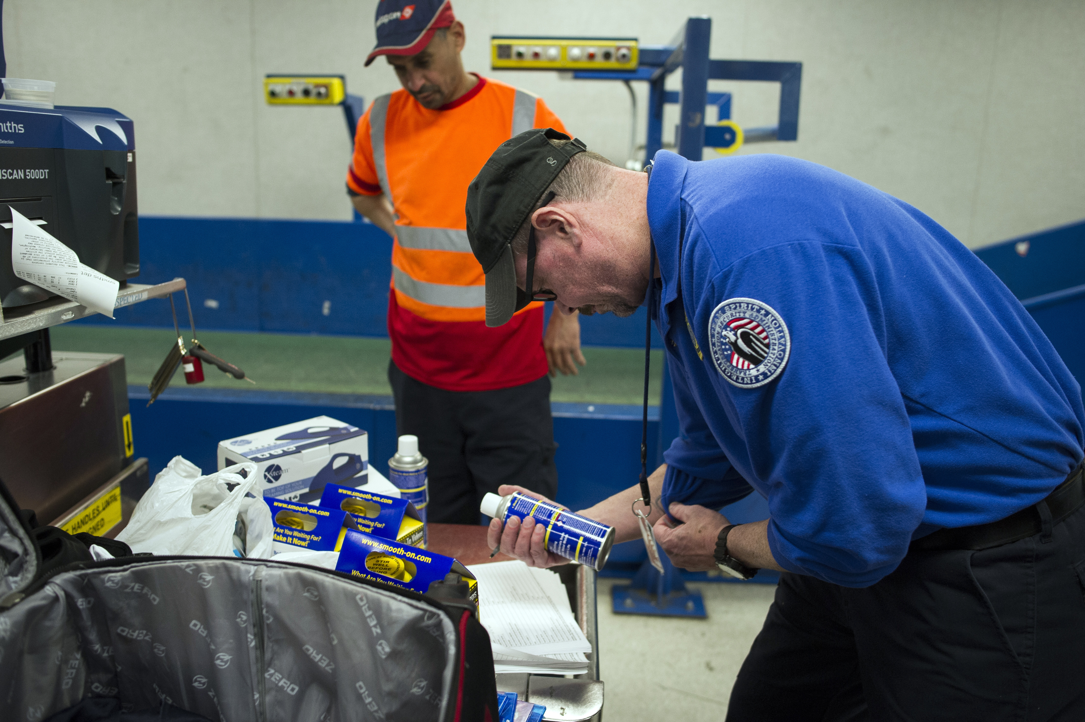 A Transportation Security Adminstration (TSA) officer inspects a can which was packed in a suitcase flagged for a seconday inspection at Dulles International Airport in Dulles, Va., March 26, 2019.