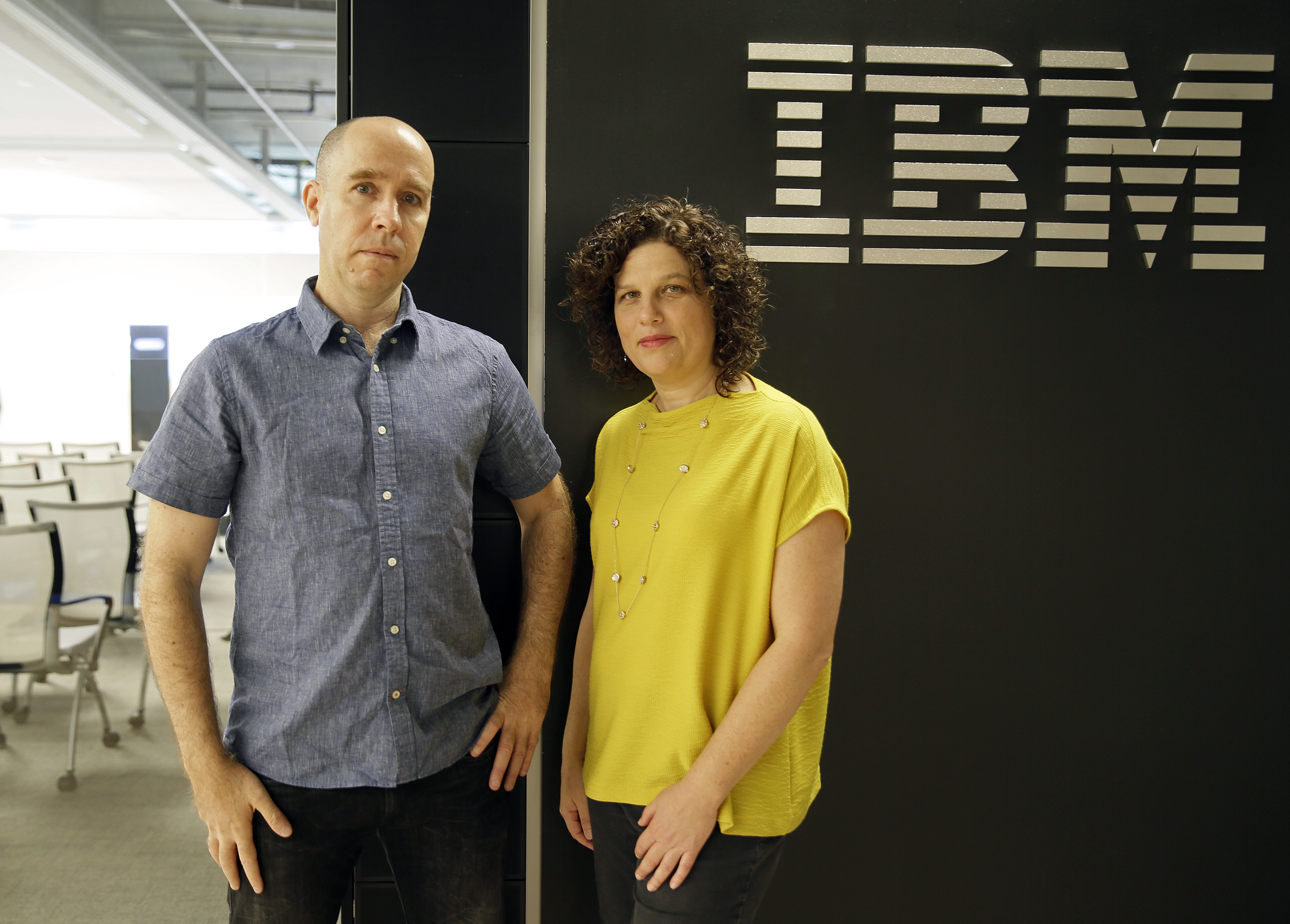 Dr. Noam Slonim, left, principal investigator, and Dr. Ranit Aharonov, right, manager, pose near the IBM Project Debater before a debate between the computer and two human debaters in San Francisco, June 18, 2018.