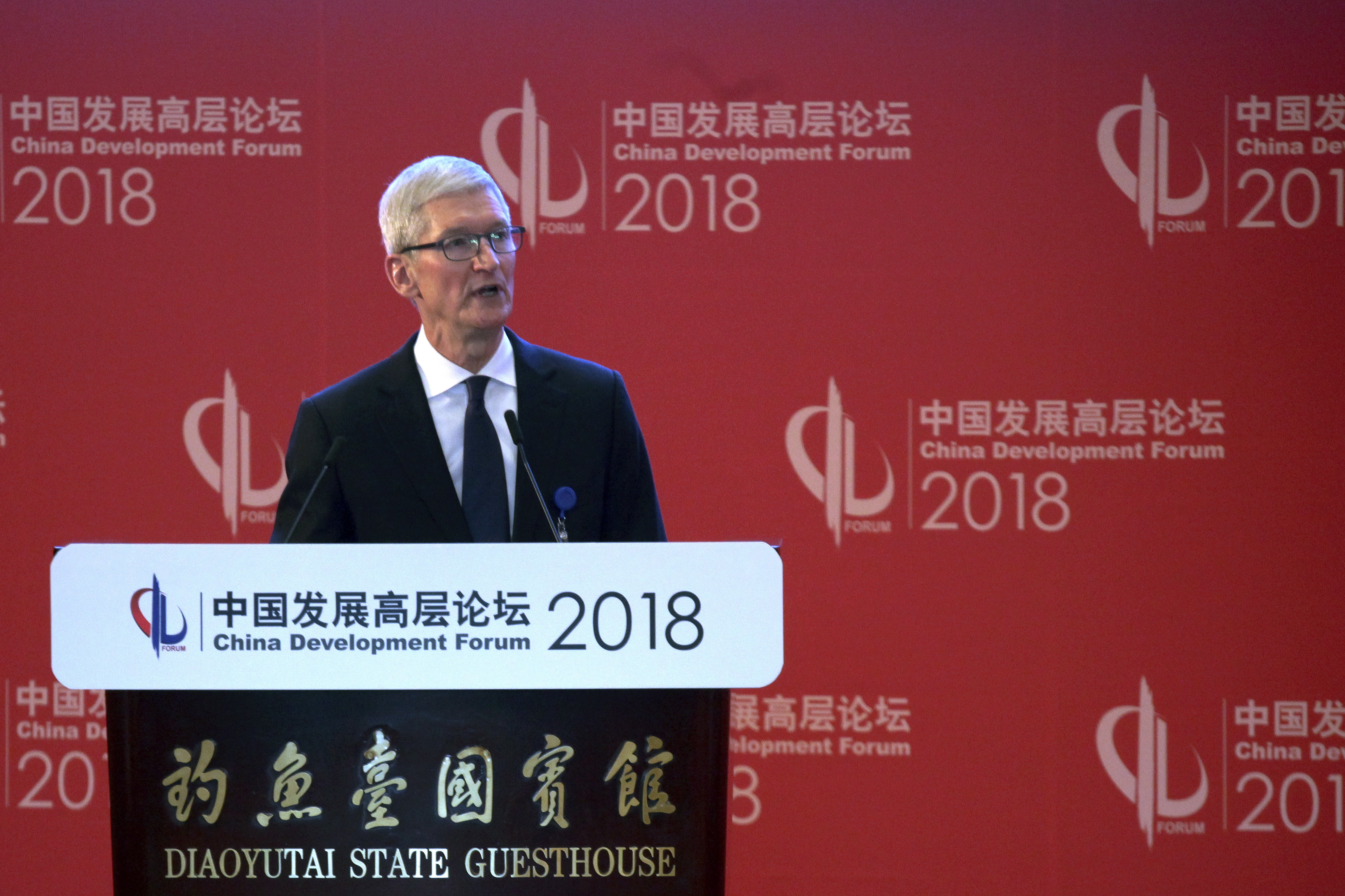 Tim Cook, Apple CEO delivers his speech at the opening ceremony of the China Development Forum held at the Diaoyutai State Guesthouse in Beijing, March 25, 2018.