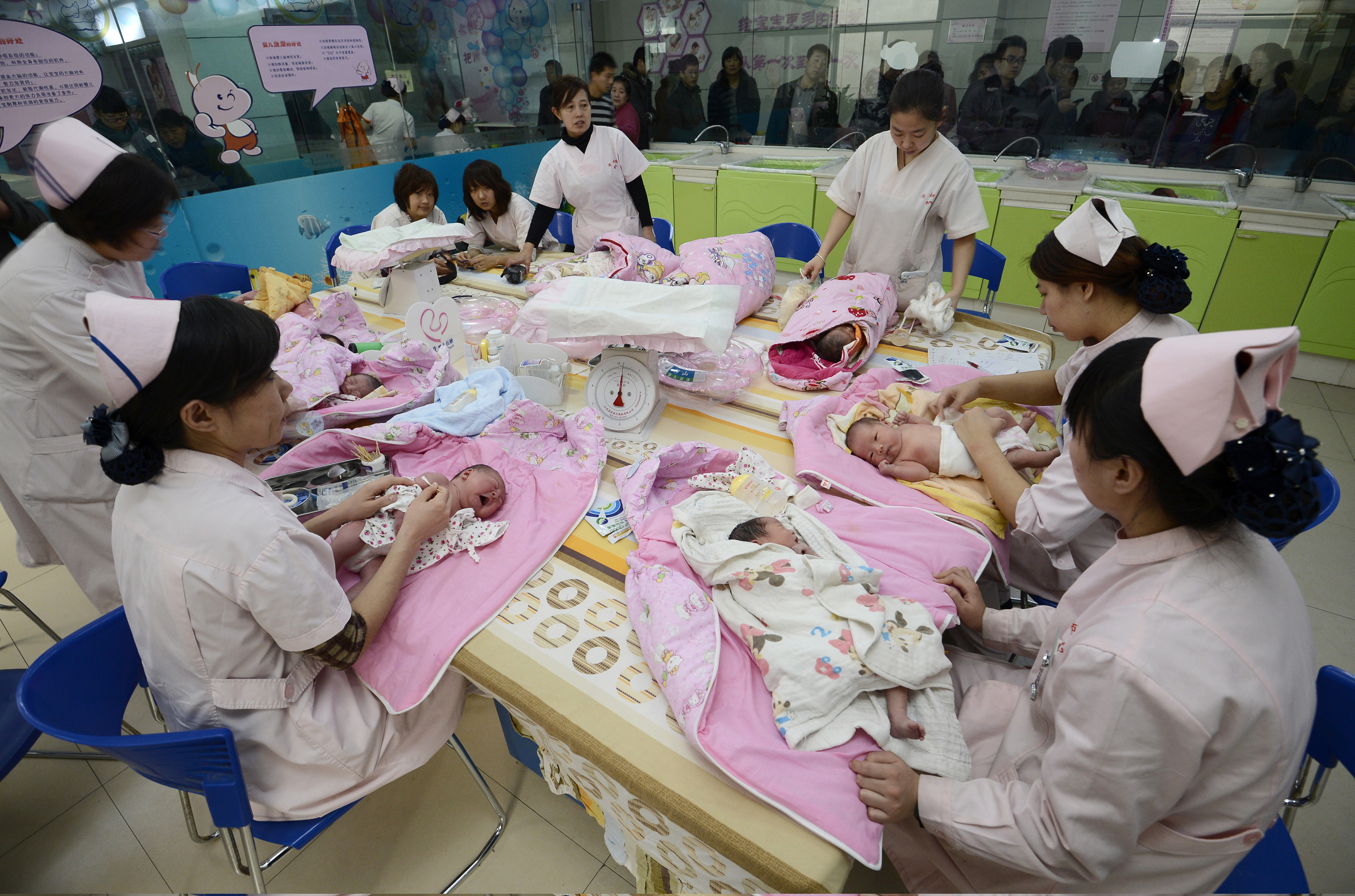 FILE - Infants undergo a daily medical examination at a maternal and child health care hospital in Taiyuan, Shanxi province, Dec. 3, 2012. Analysts say China's new two-child policy could spur economy.