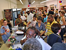 A diverse crowd fills the Old North Grocery Co-op on opening day.