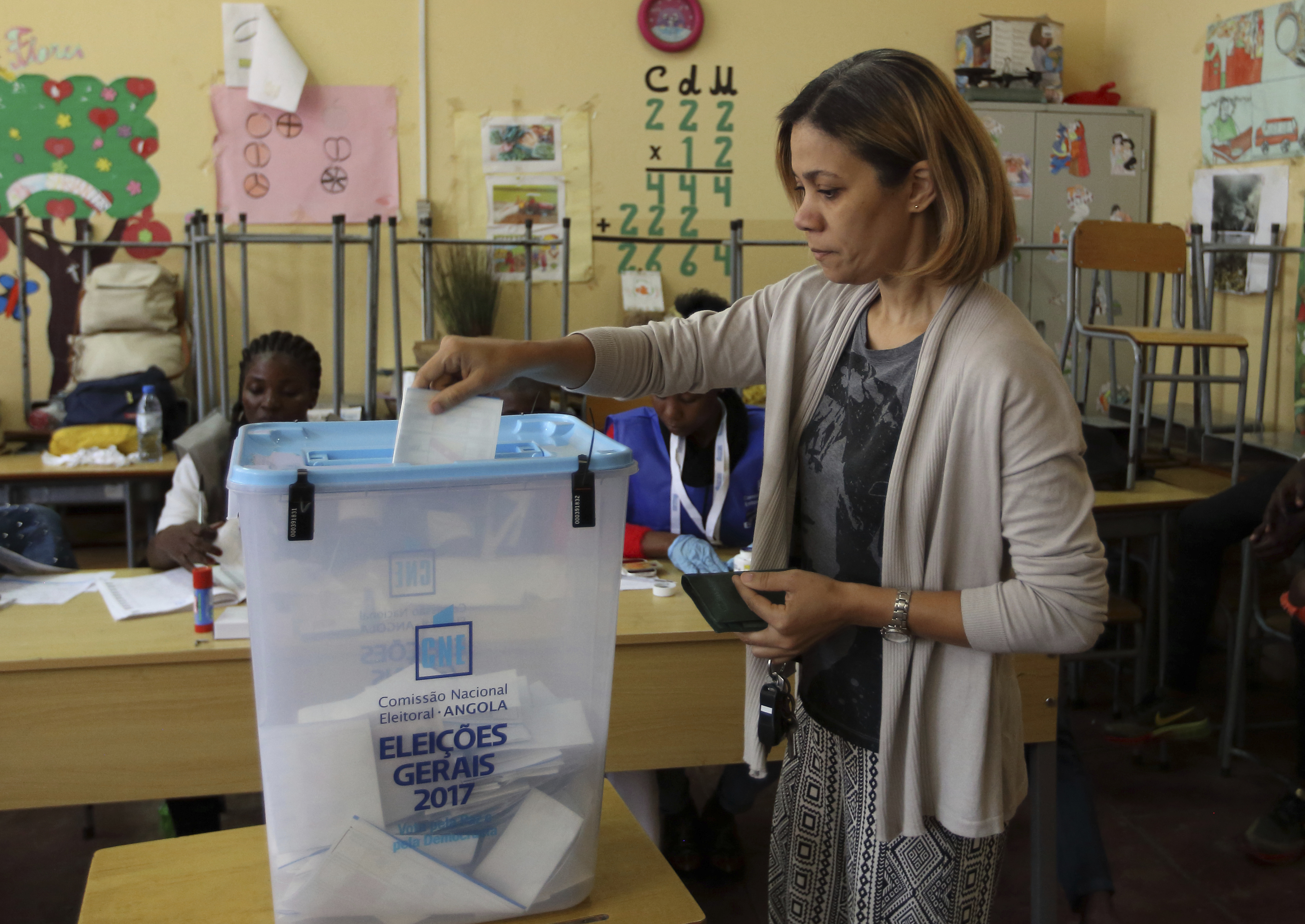 A voter casts her ballot in elections in Luanda, Angola, Aug. 23, 2017.
