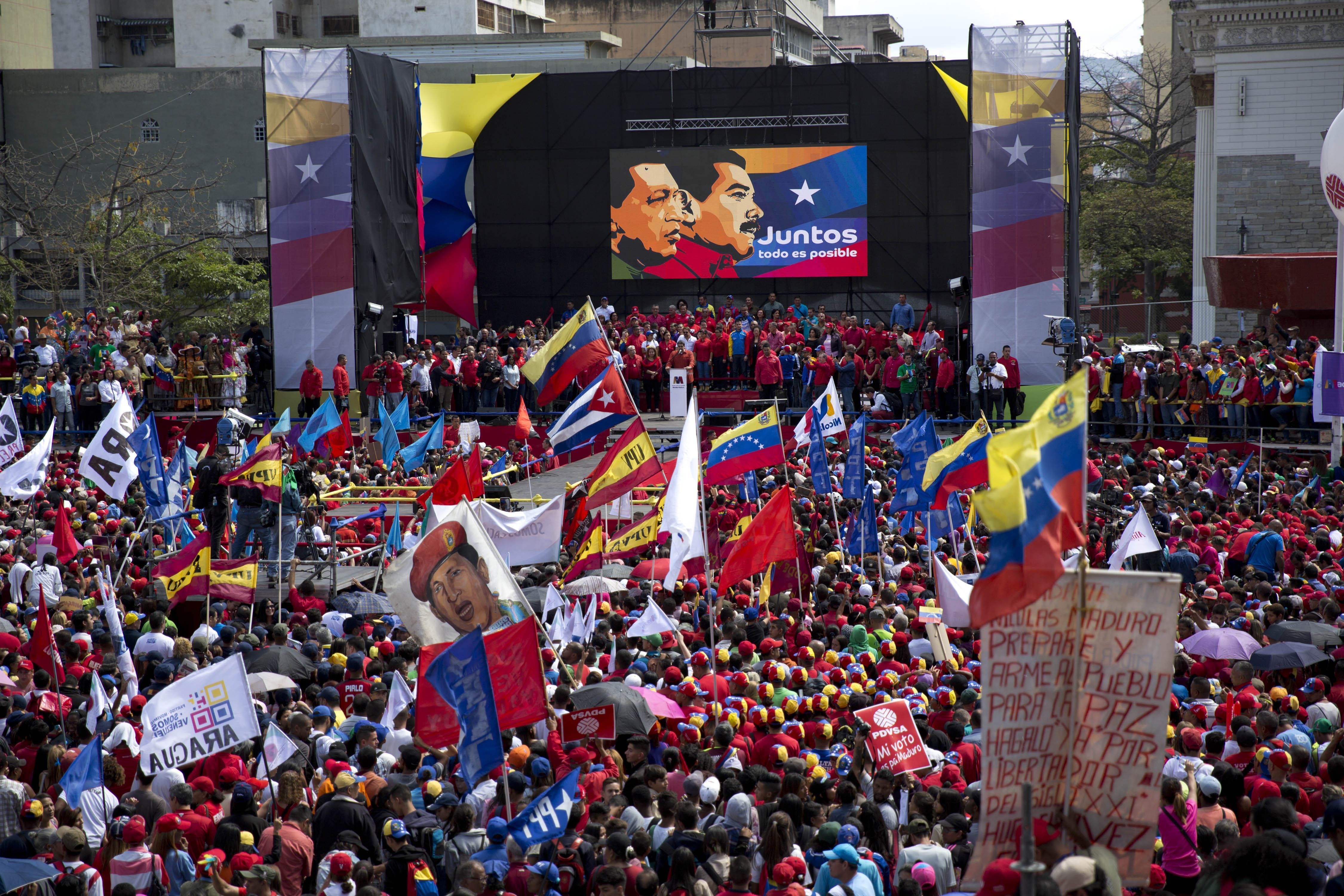 Supporters gather at Diego Ibarra Square to listen Venezuela's President Nicolas Maduro speak after a ceremony formalizing his candidacy for the upcoming presidential election, in Caracas, Venezuela, Feb. 27, 2018.