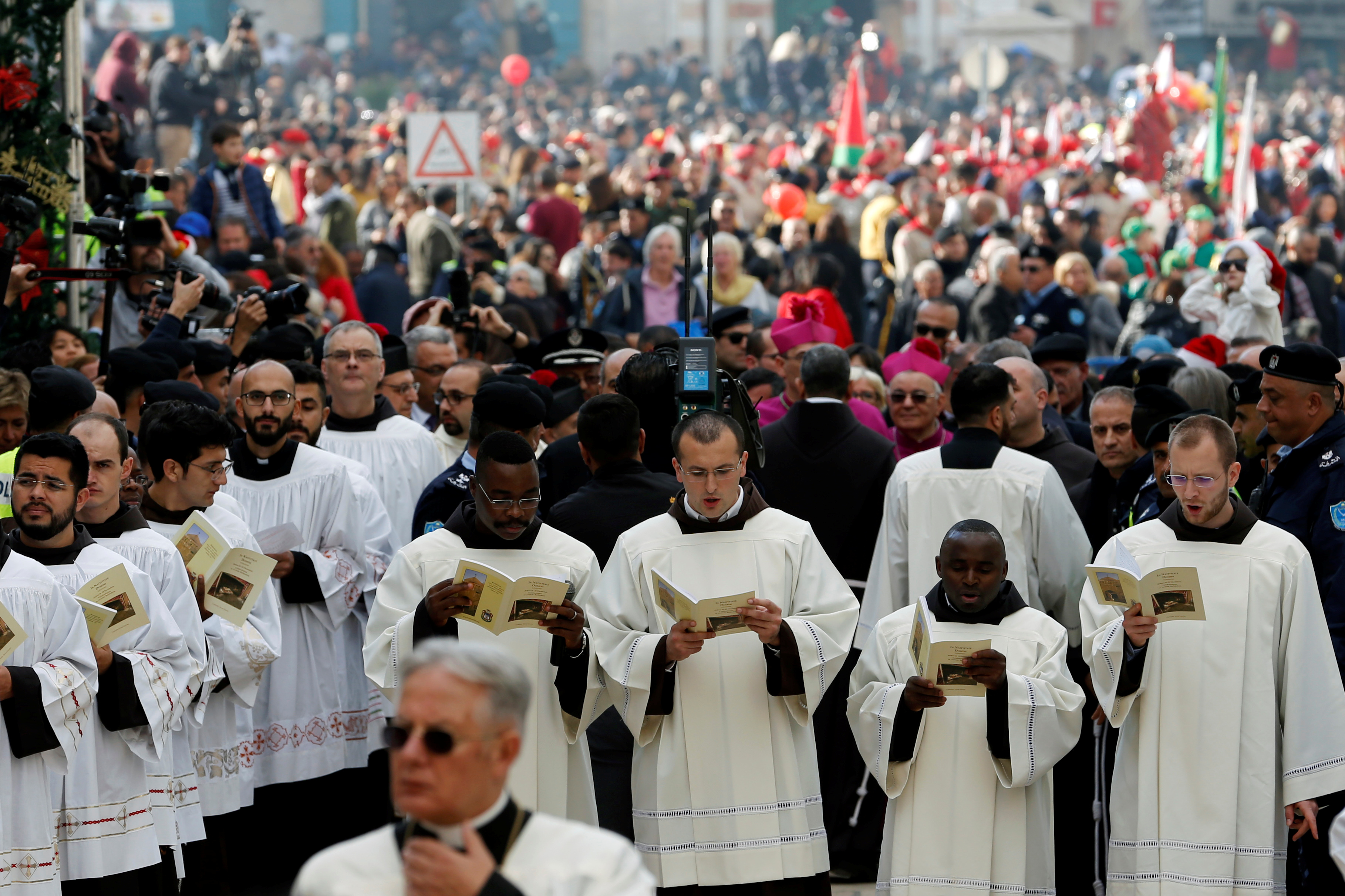 Clergymen attend Christmas celebrations at Manger Square outside the Church of the Nativity in Bethlehem, in the Israeli-occupied West Bank, Dec. 24, 2018.