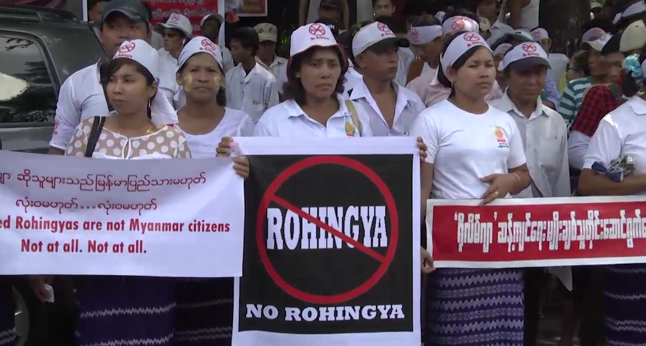 """Demonstrators hold banners outside the U.S. Embassy in Yangon, Myanmar, April 28, 2016, to protest against the embassy's use of the word """"Rohingya."""""""