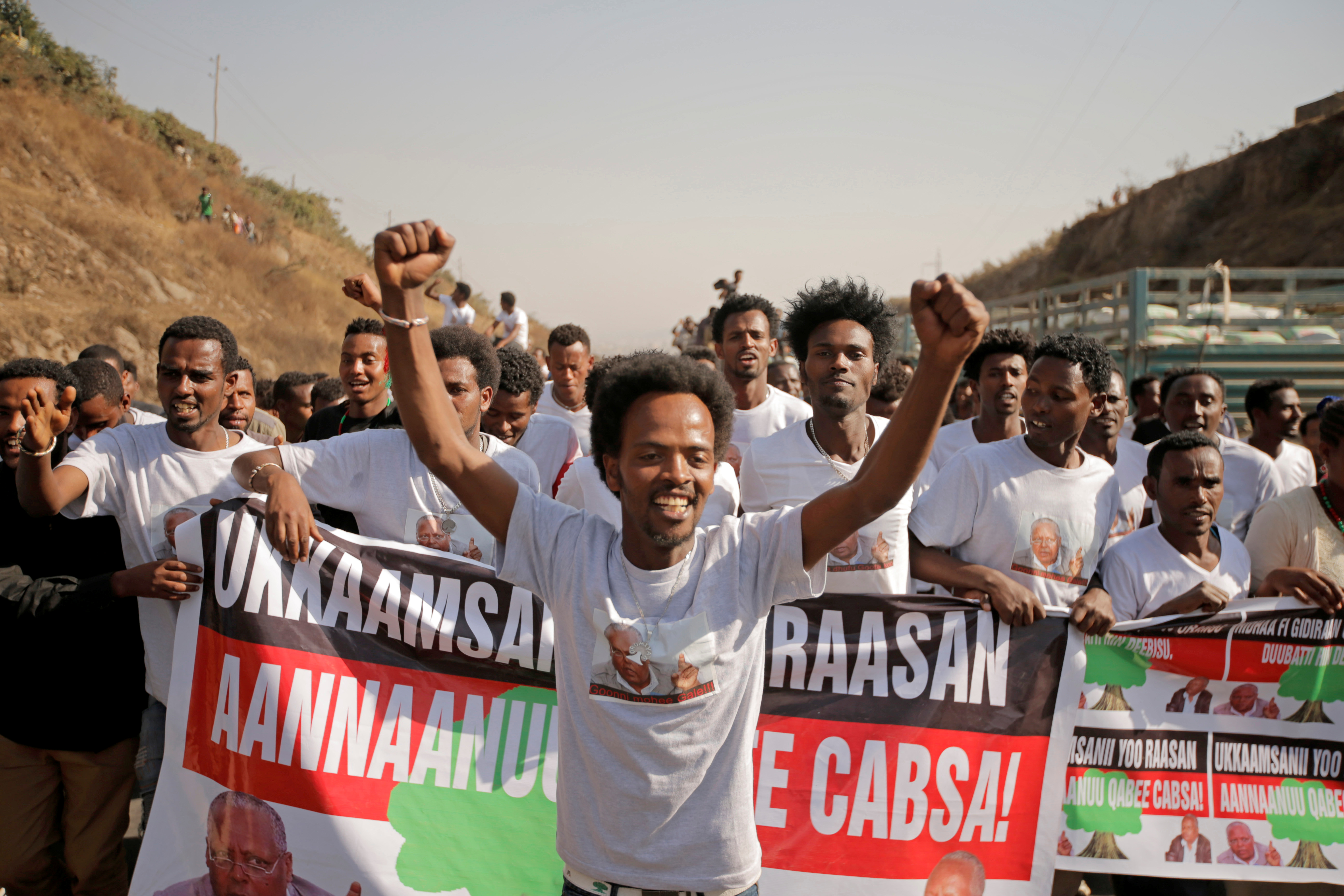 Supporters celebrate as they welcome Merera Gudina, leader of the Oromo Federalist Congress party after his release from prison in Addis Ababa, Ethiopia, Jan. 17, 2018.